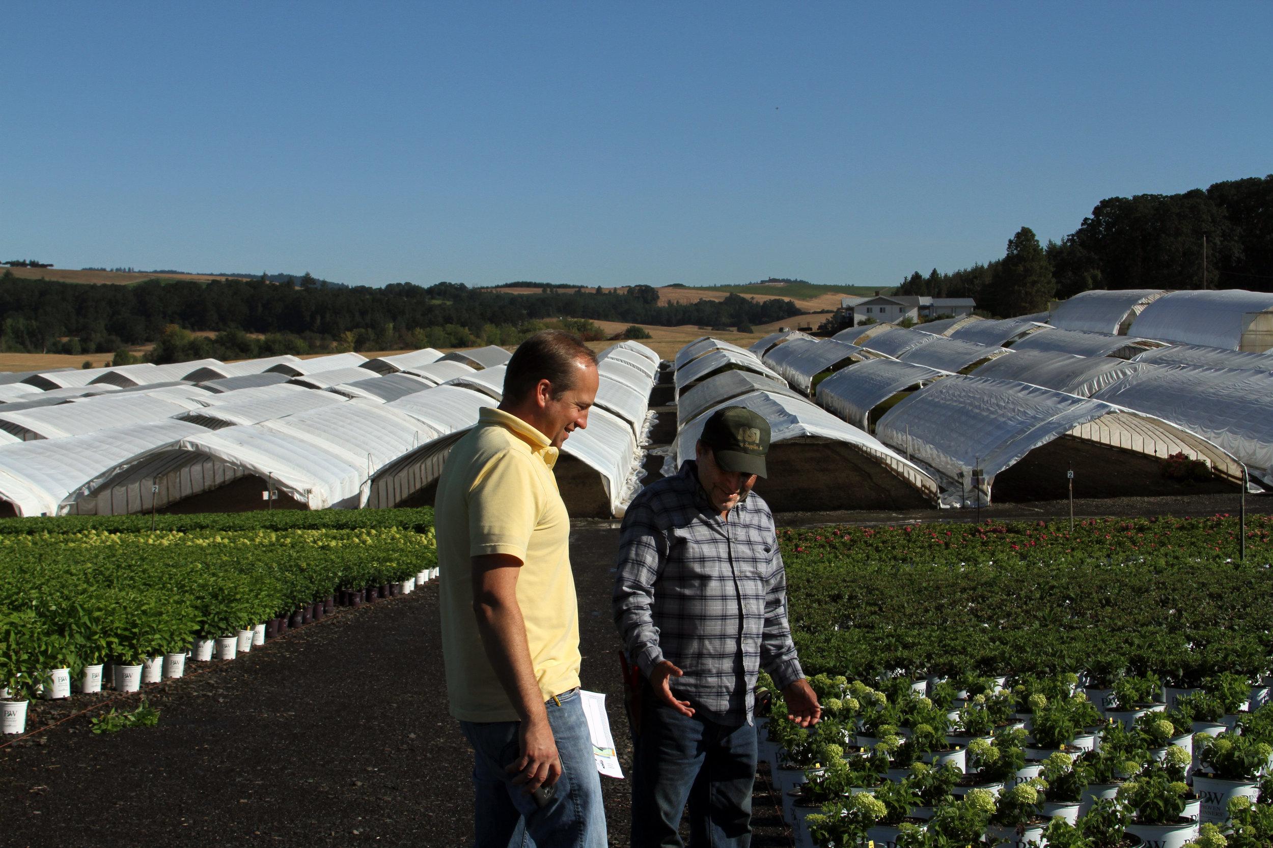Gabriel and Sergio talking plants.