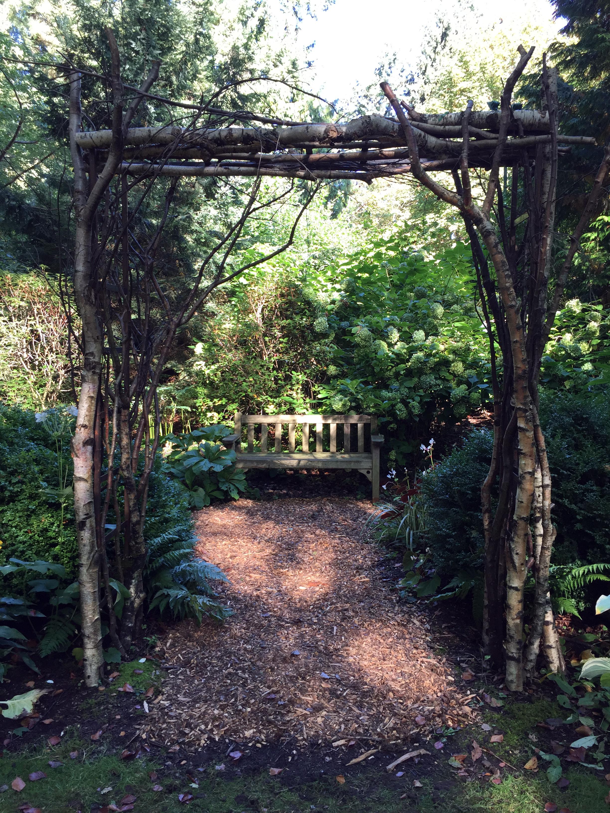 An Arbor Frames a Garden Bench