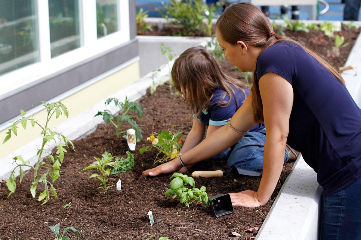 girl and woman planting veggies.jpg