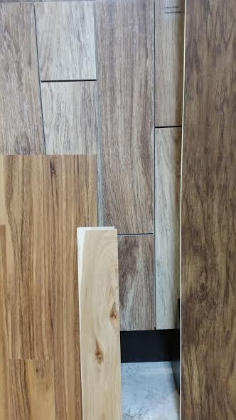From left to right  LVP, solid wood, porcelain, and WPC