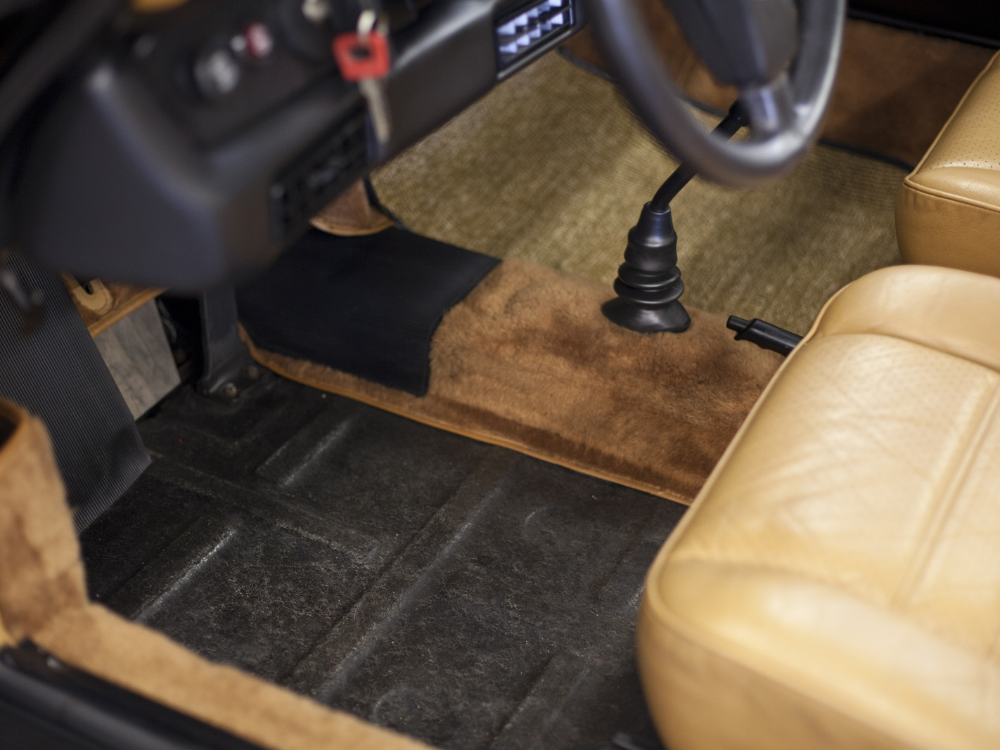 This photo is just to show how clean the car is. The carpet was just pulled out for the photo.