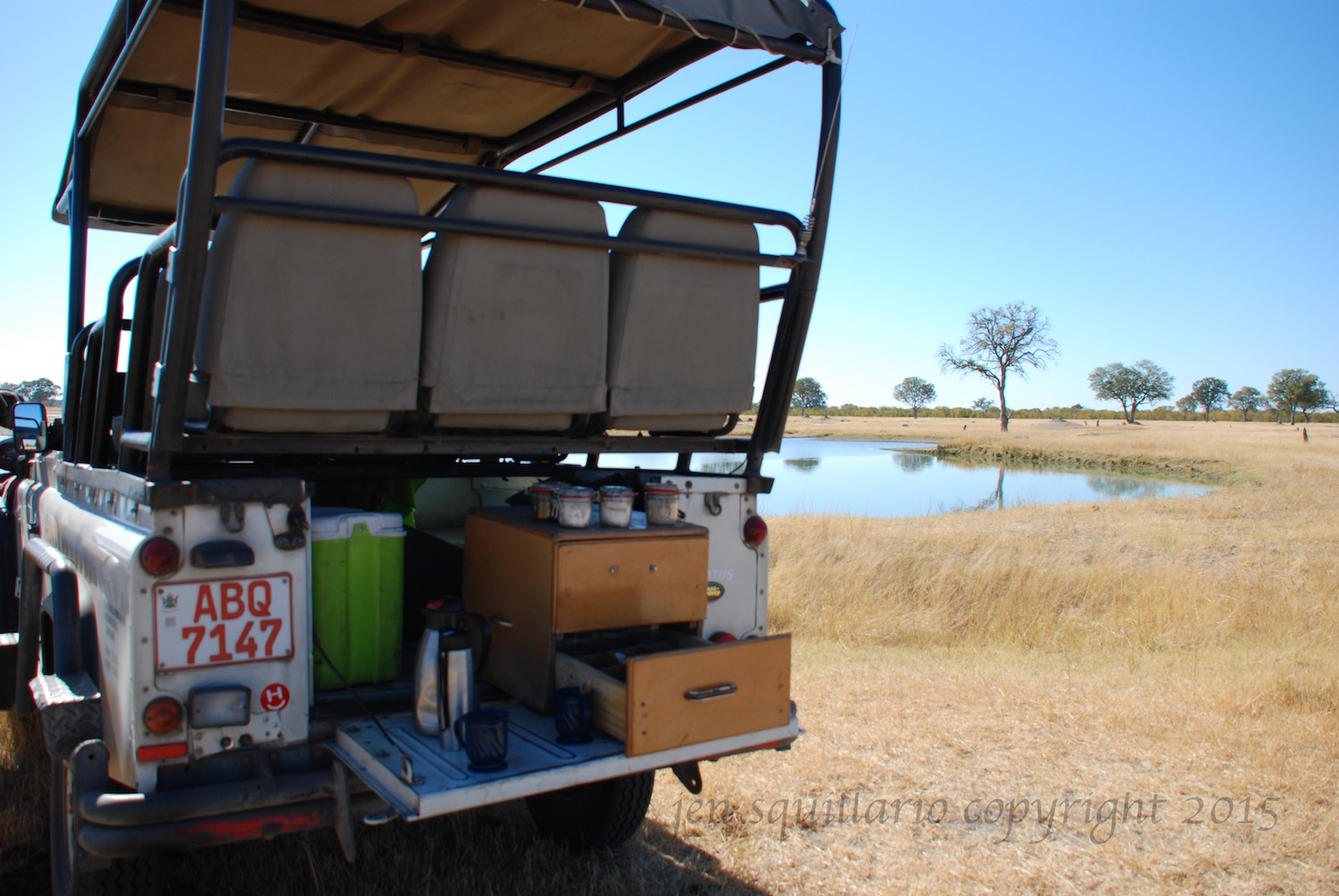 Our safari vehicle on our photographic safari in the Hwange National Park in Zimbabwe in June (winter in Zimbabwe).  The back of the vehicle is set up for morning coffee and tea.  See  www.wilderness-safaris.com  for more information.