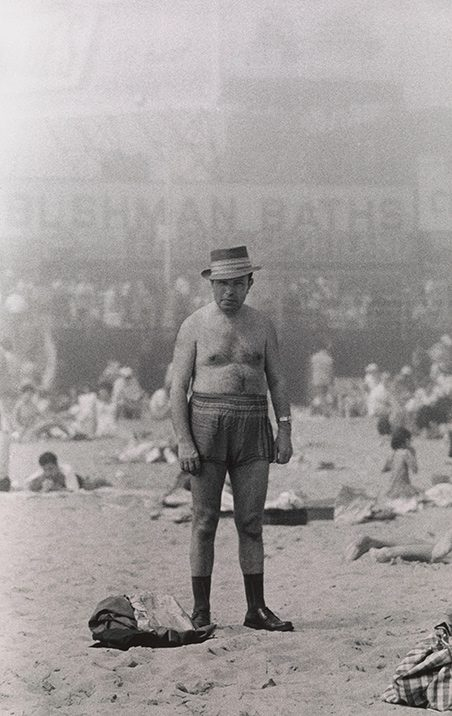 Arbus, Diane. Man in hat, trunks, socks and shoes, Coney Island, N.Y. 1960.