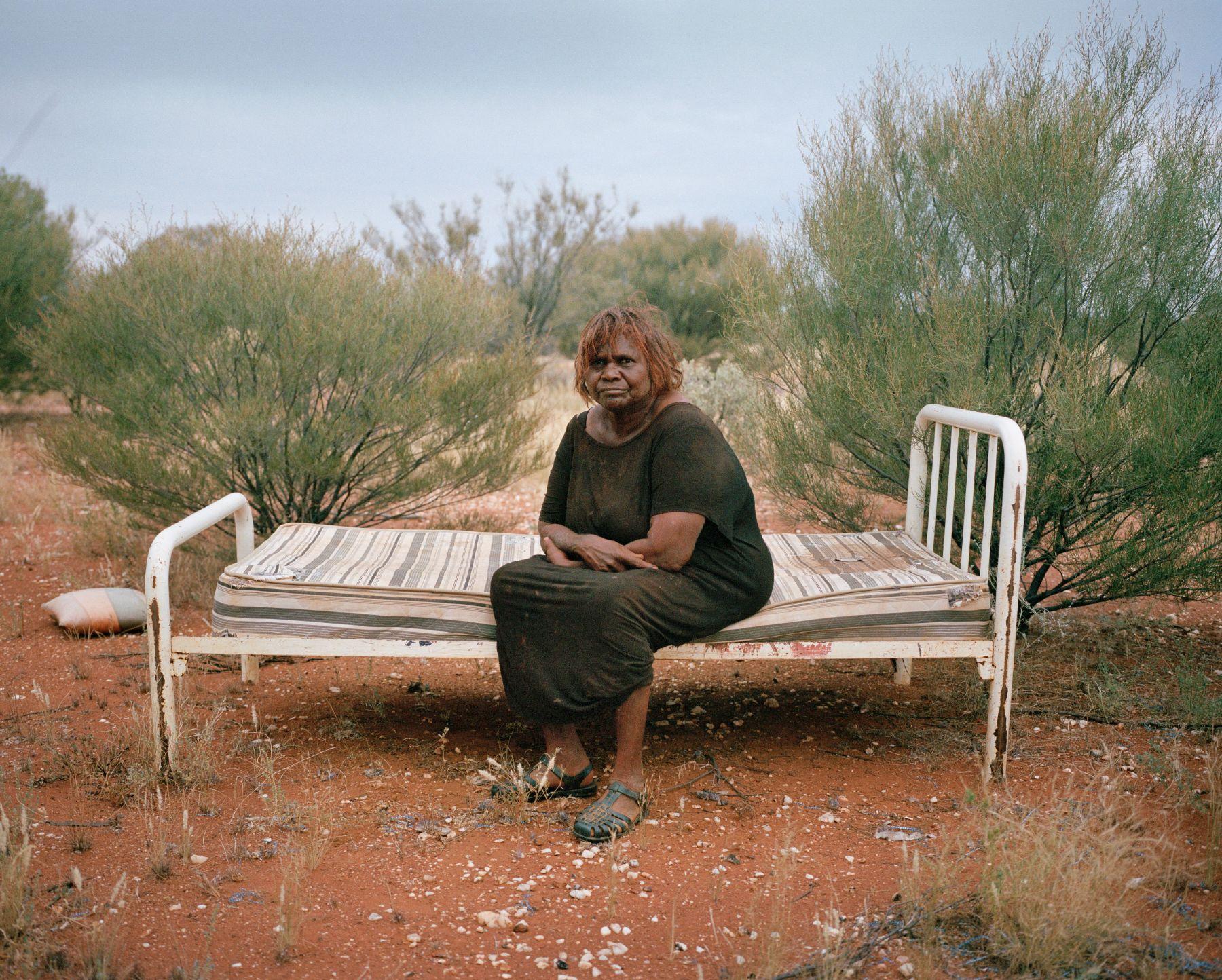 Daisy Ward, an Aboriginal-Australian elder from Warakurna Community, sits for a portrait at a 'sorry place' near Warakurna Community, Ngaanyatjarraku Shire, Western Australia on Mar. 8, 2017. Adam Ferguson