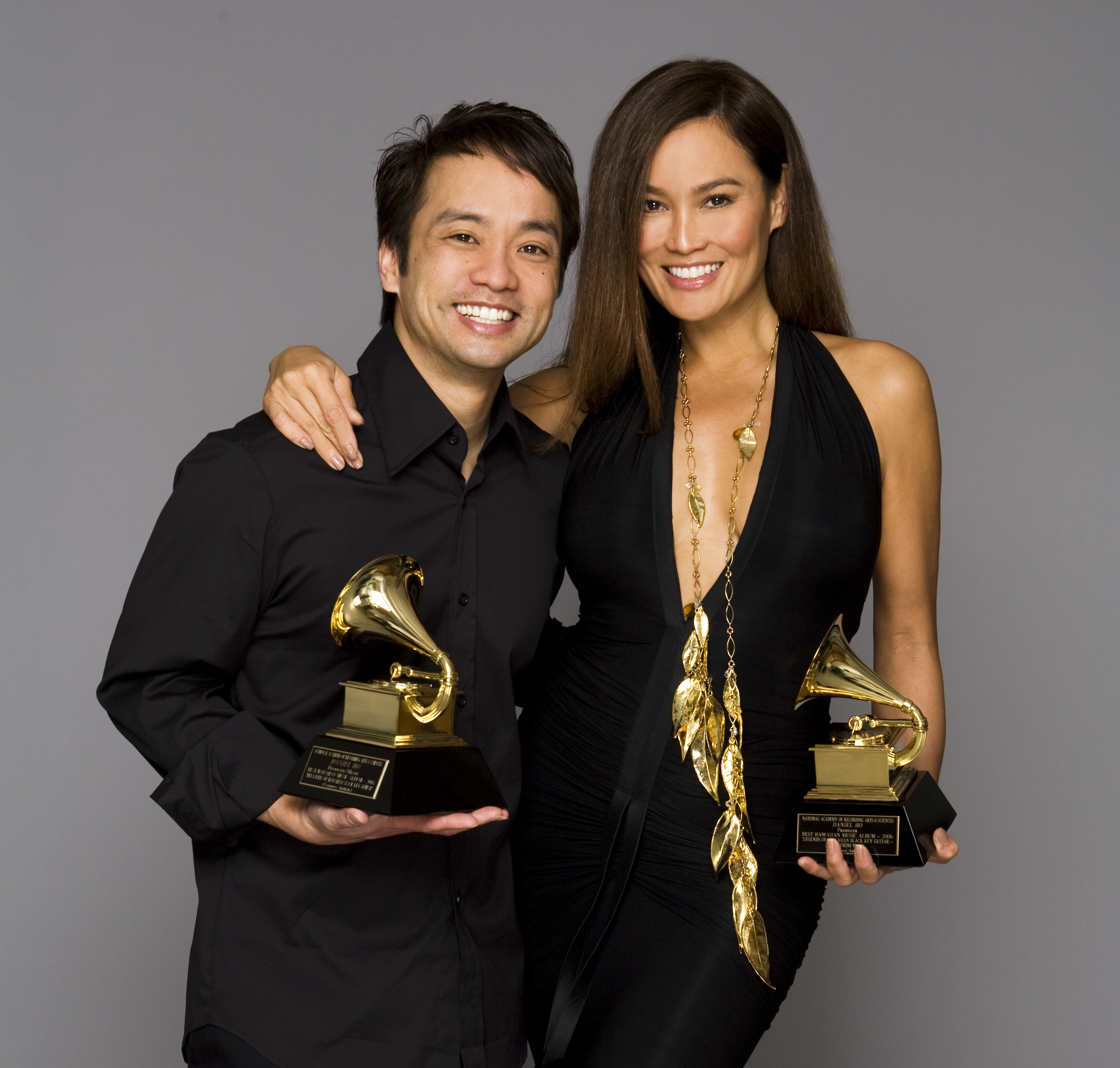 Daniel Ho & Tia Carrere with Grammy Awards