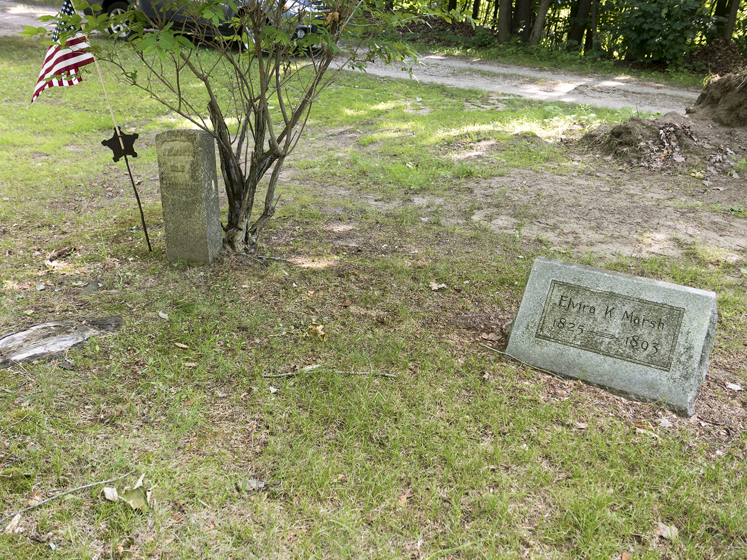 buried next to his first wife Elvira