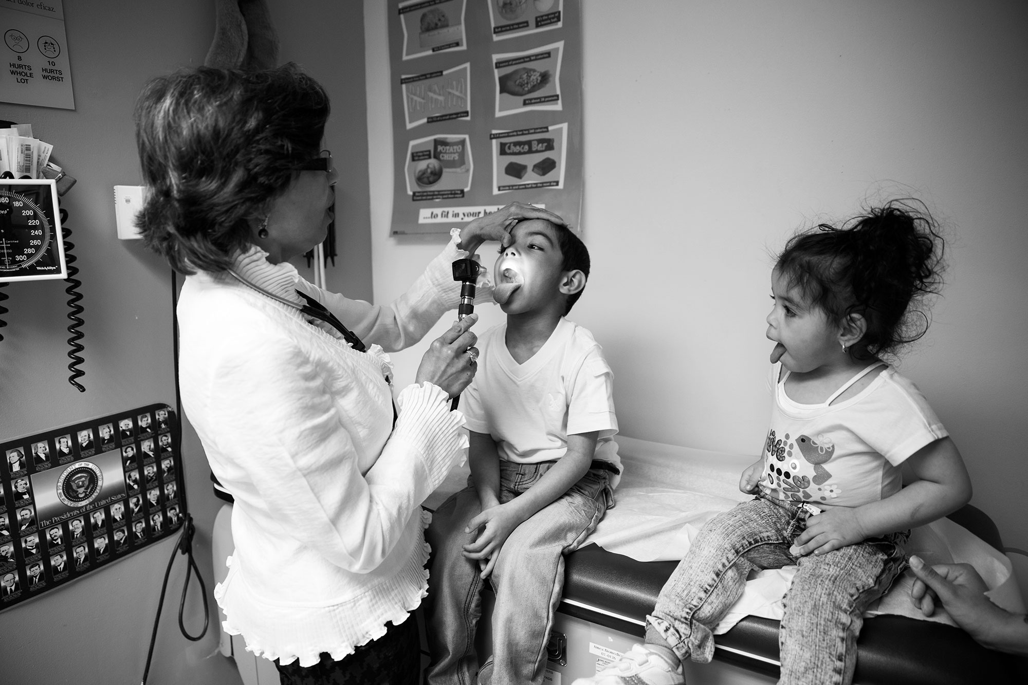 """Dr. Acklema Mohammad, the head pediatrician at the Urban Health Plan in the South Bronx, helped develop the Asthma Action Plan, a national """"go-to"""" guideline for asthma patients to understand how and when to take their asthma medication. Dr. Mohammad gives a check-up to 5 year old Asthma patient Kelvin Torres and his two year old sister, Janalisse.  Originally published by NBC News & NBC Dateline, as part of their story   'Mold, Mice and Zip Codes: Inside The Childhood Asthma Epidemic.'"""