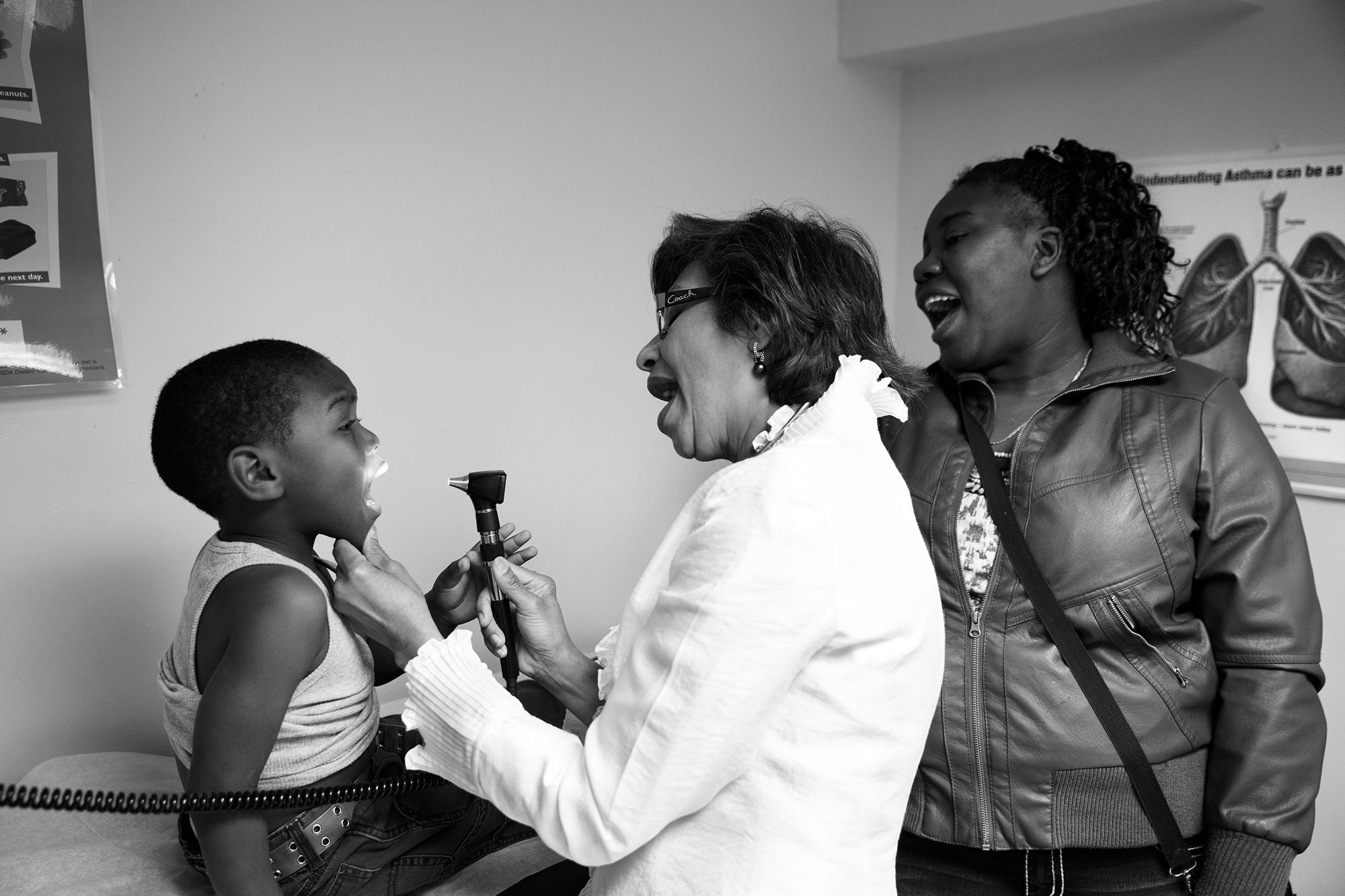 Asthma patient Onilson Avila Dionicio, 4, is examined by Dr. Mohammad while his mother watches.