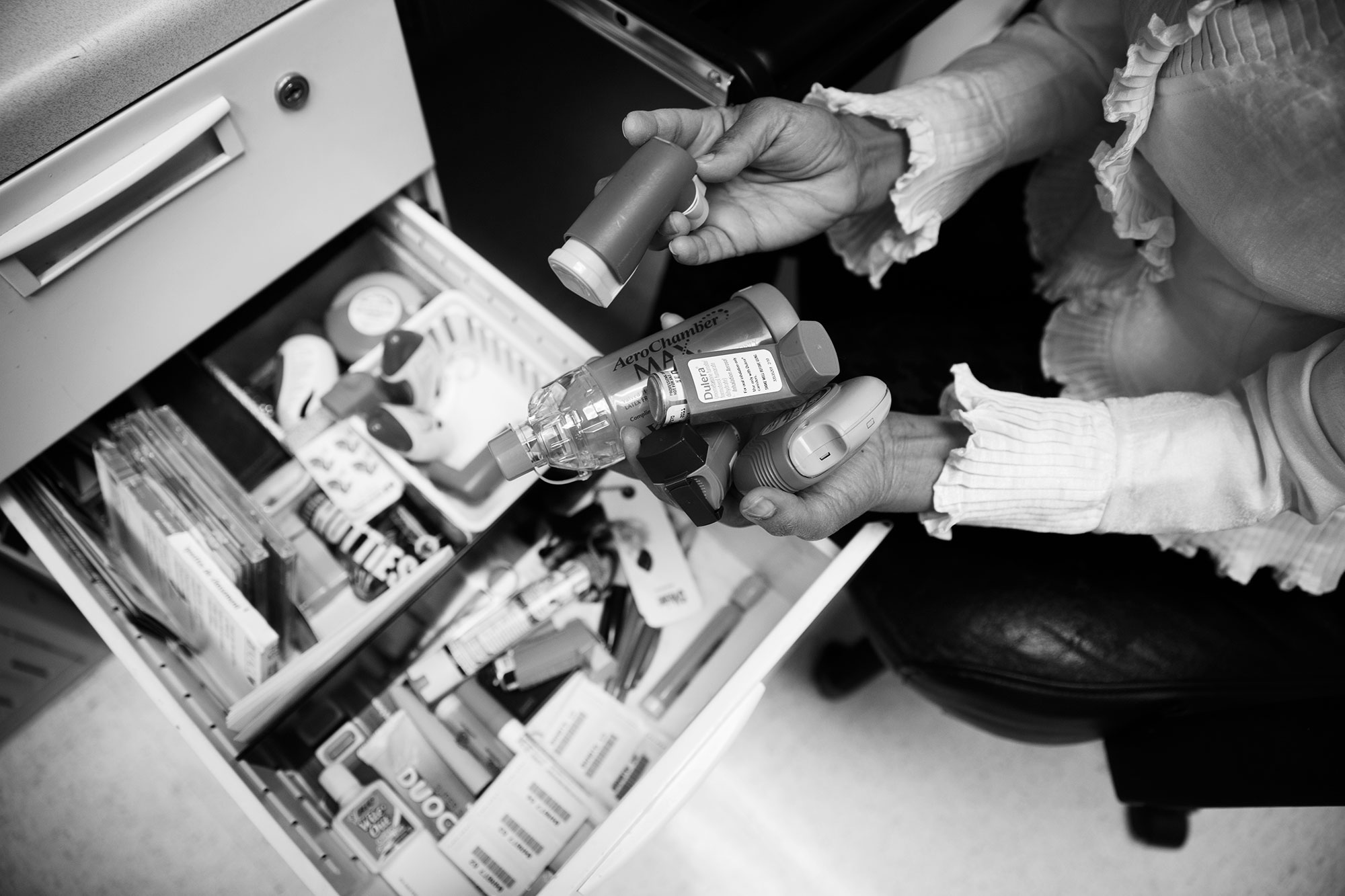 """Dr. Mohammad has various asthma medication samples in her desk drawers like the """"pump"""", spacer, diskus, which she uses to explain to patients and parents on how to use them adequately."""
