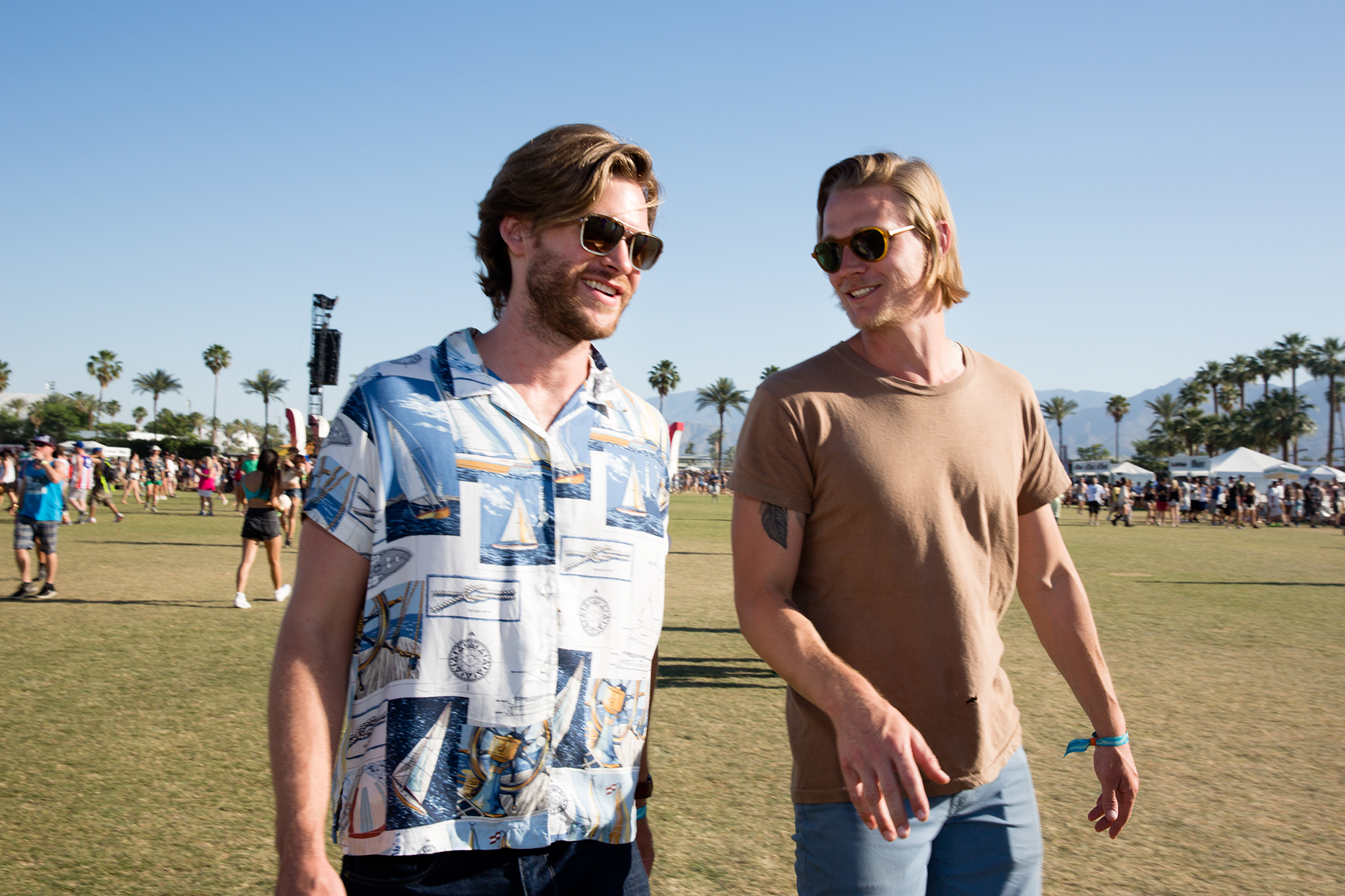 Jamestown Revival's Jonathan Clay and Zach Chance walk to the artist compound on April 18, 2015. Mr. Clay and Mr. Chance grew up together in the small Texas town of Magnolia. This year is their Coachella debut.  Originally published by The Wall Street Journal, as part of their story  ' Behind the Scenes at Coachella With Jamestown Revival.'