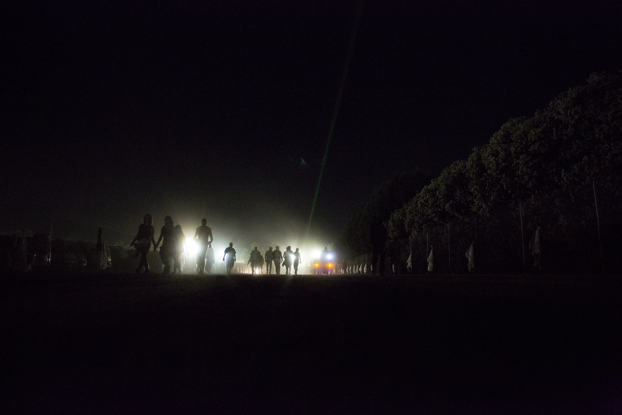 Festival-goers walk through the grounds on Friday night weekend two at Coachella.
