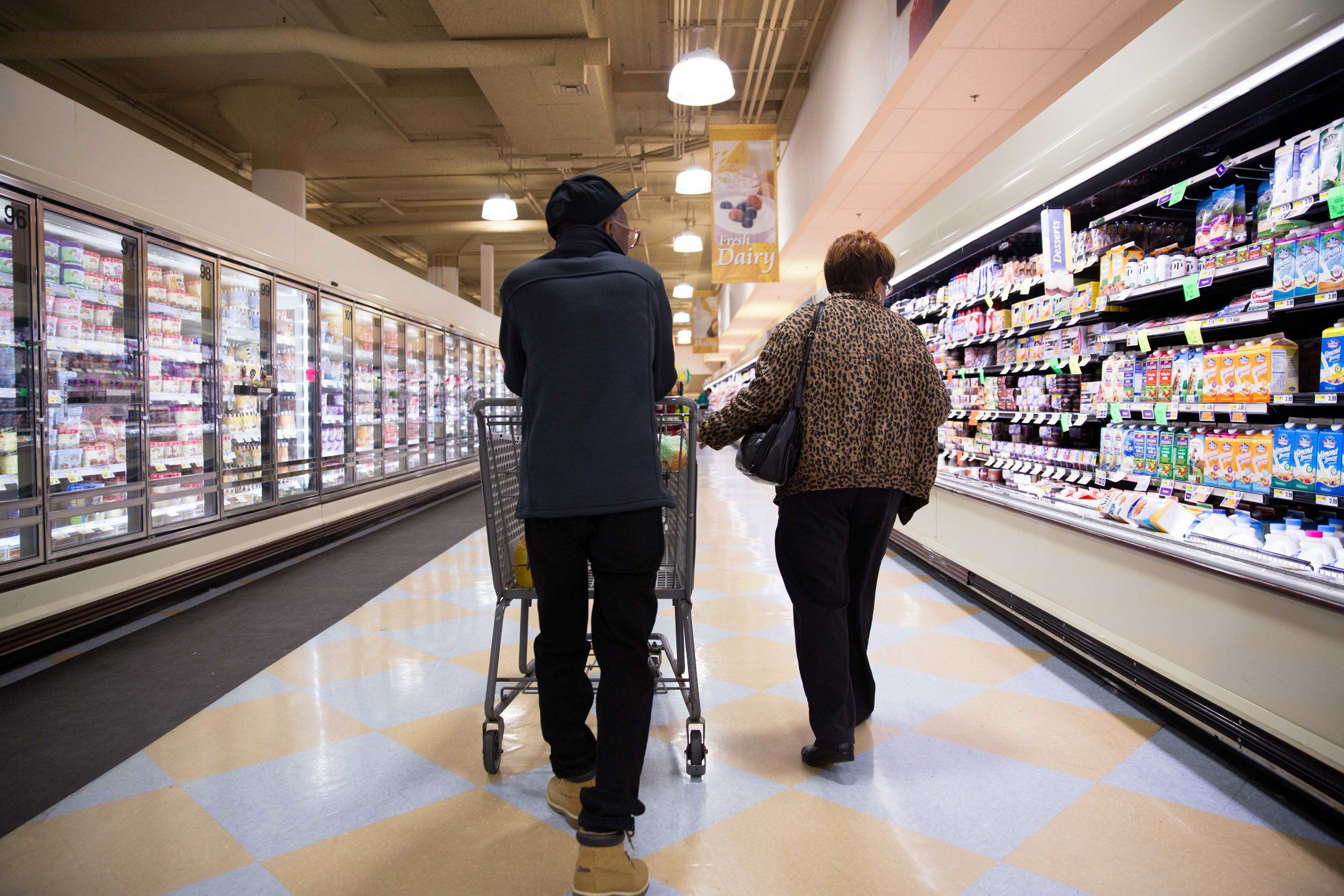 """Ronald and his mother Willie Mae go grocery shopping for the week in Philadelphia, a day after Ronald's release from St. Clair Correctional Facility in Alabama. """"I'm so tired of chicken and hot dogs, baloney,"""" Ronald says, as he speaks about what he's most excited to eat out of prison. """"What I'd really like to eat is some glazed donuts. It's been so long—I love glazed donuts."""""""