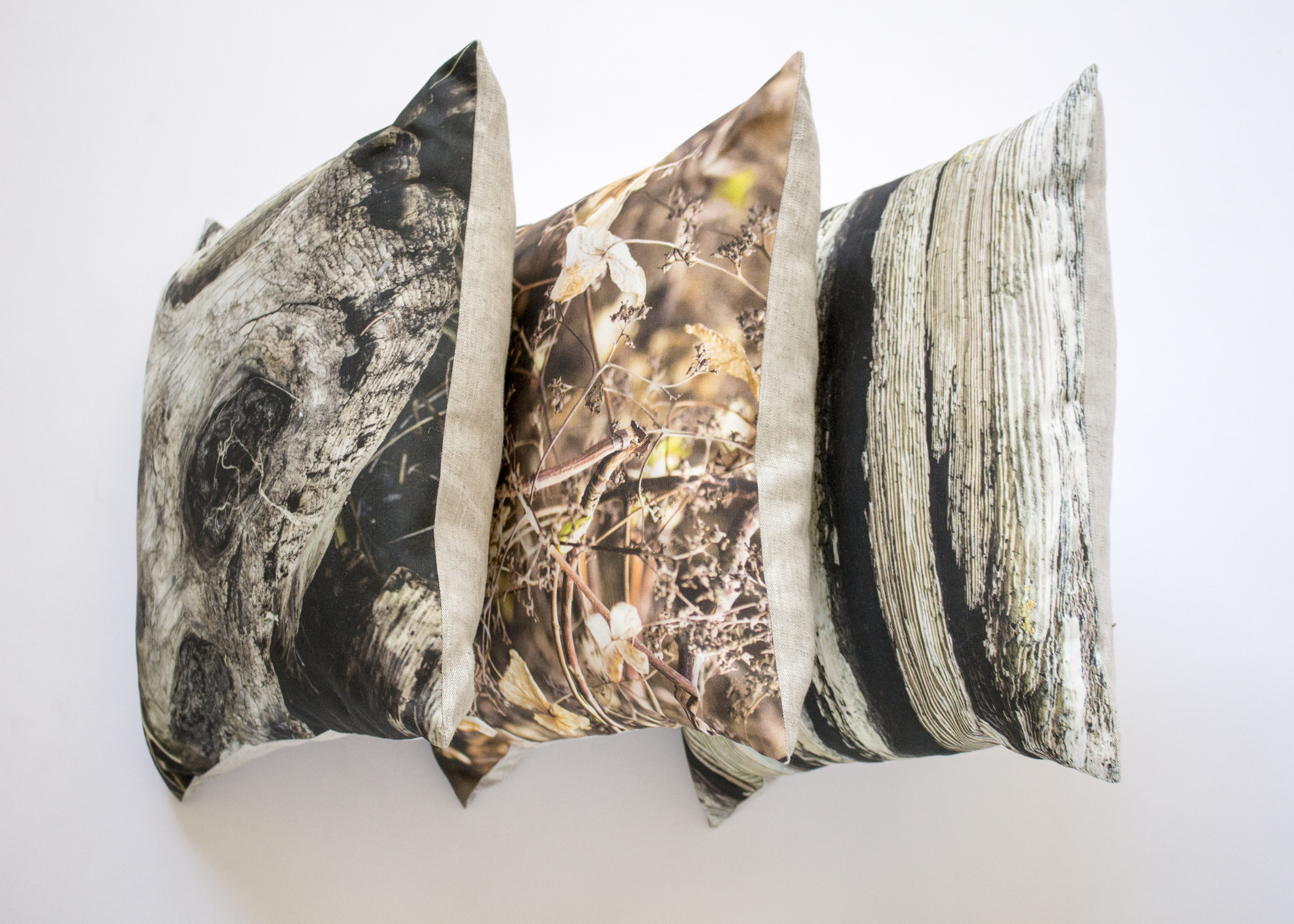 Three of Kær's most popular pillows, bringing the great outdoors—like driftwood and lacy leaves—inside.