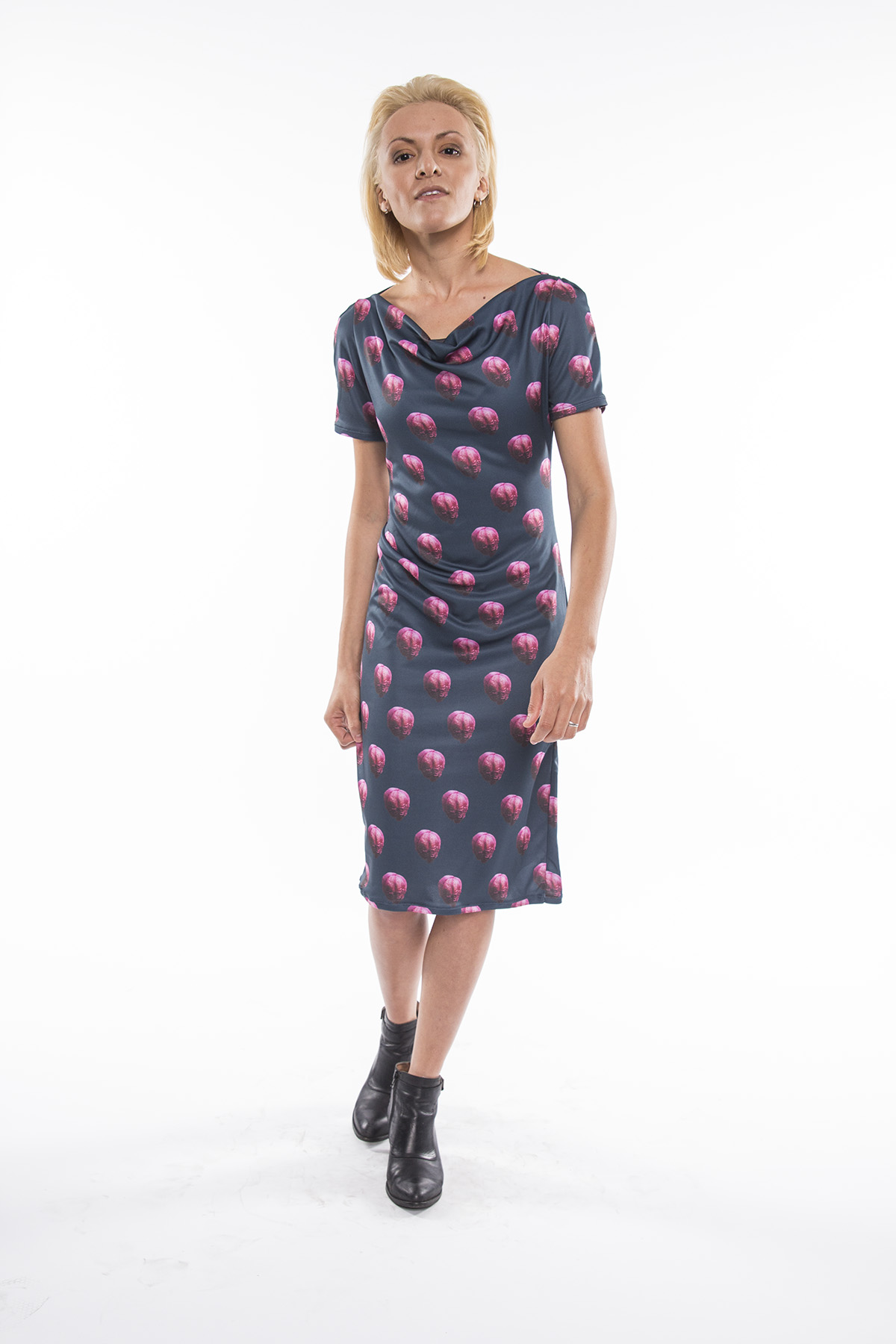 Danie is wearing the mysterious print on our popular Marie dress. Get it  here !