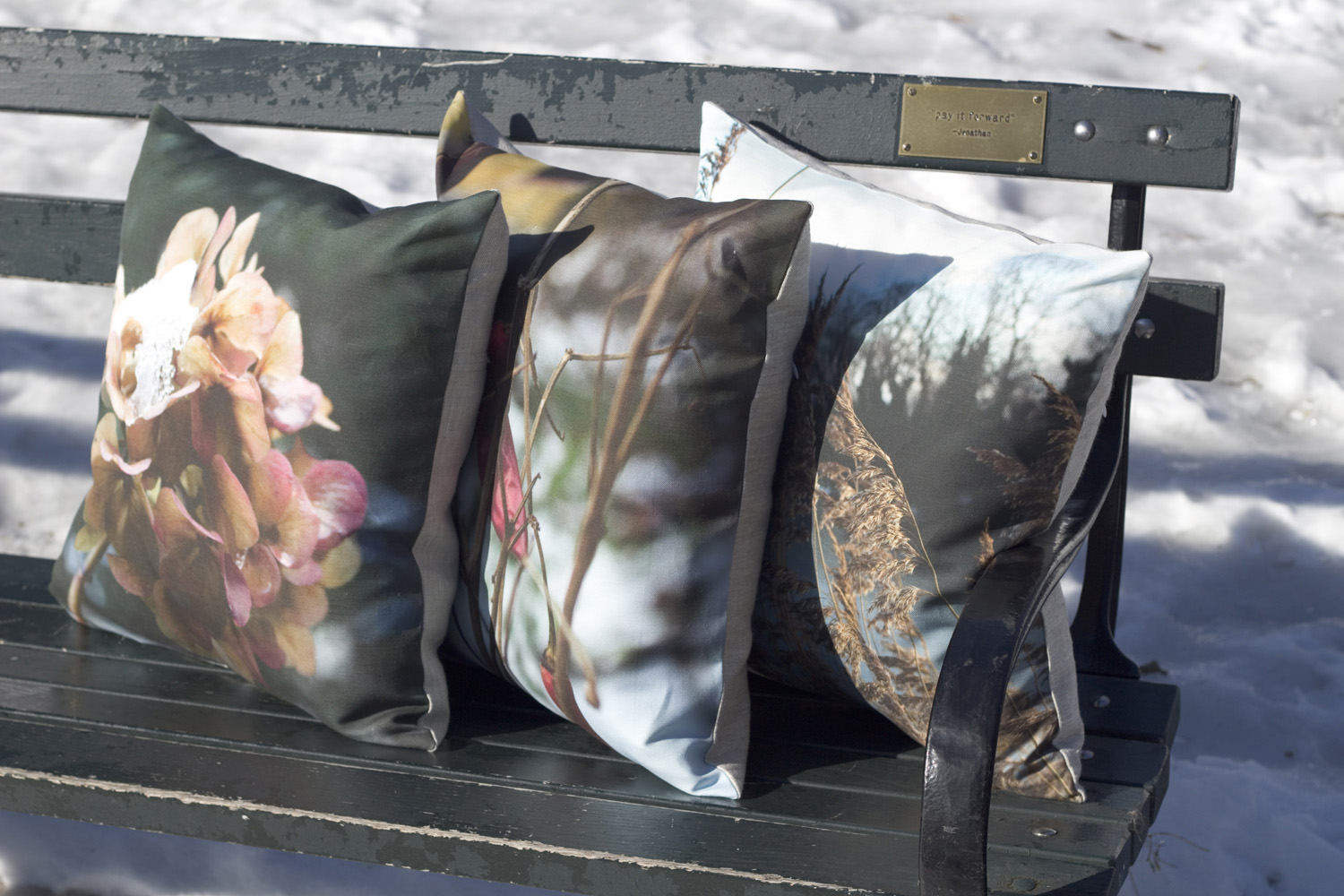I don't usually schlepp pillows into the park when it's snowing, but on special occasions... Left to right:  Hydrangea ,  Chilis in the Snow , and  Christiania  linen pillows.