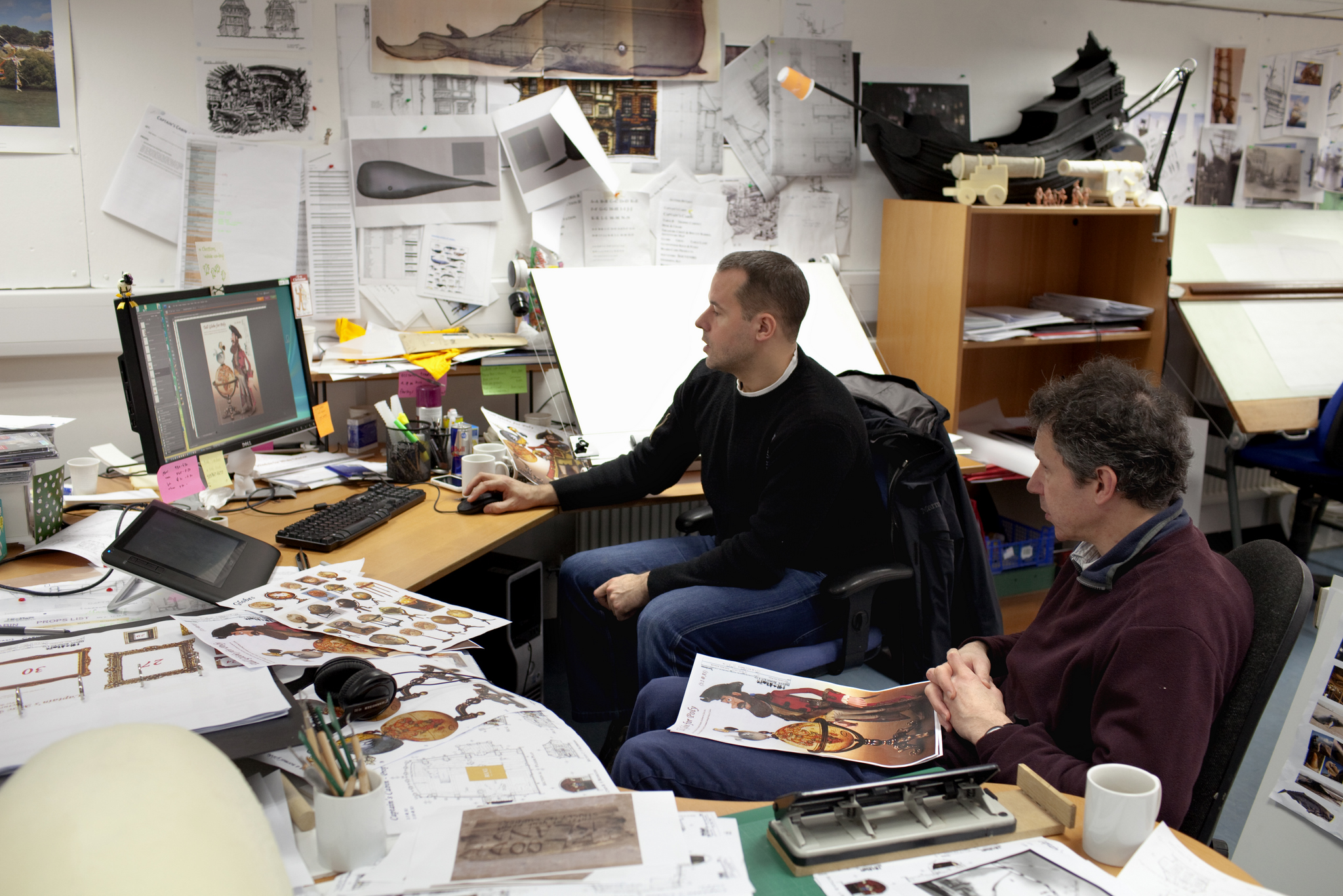 Matt Saunders, Art Director, and Jeff Newitt, Co-Director, go over the set designs on the set of THE PIRATES! BAND OF MISFITS.