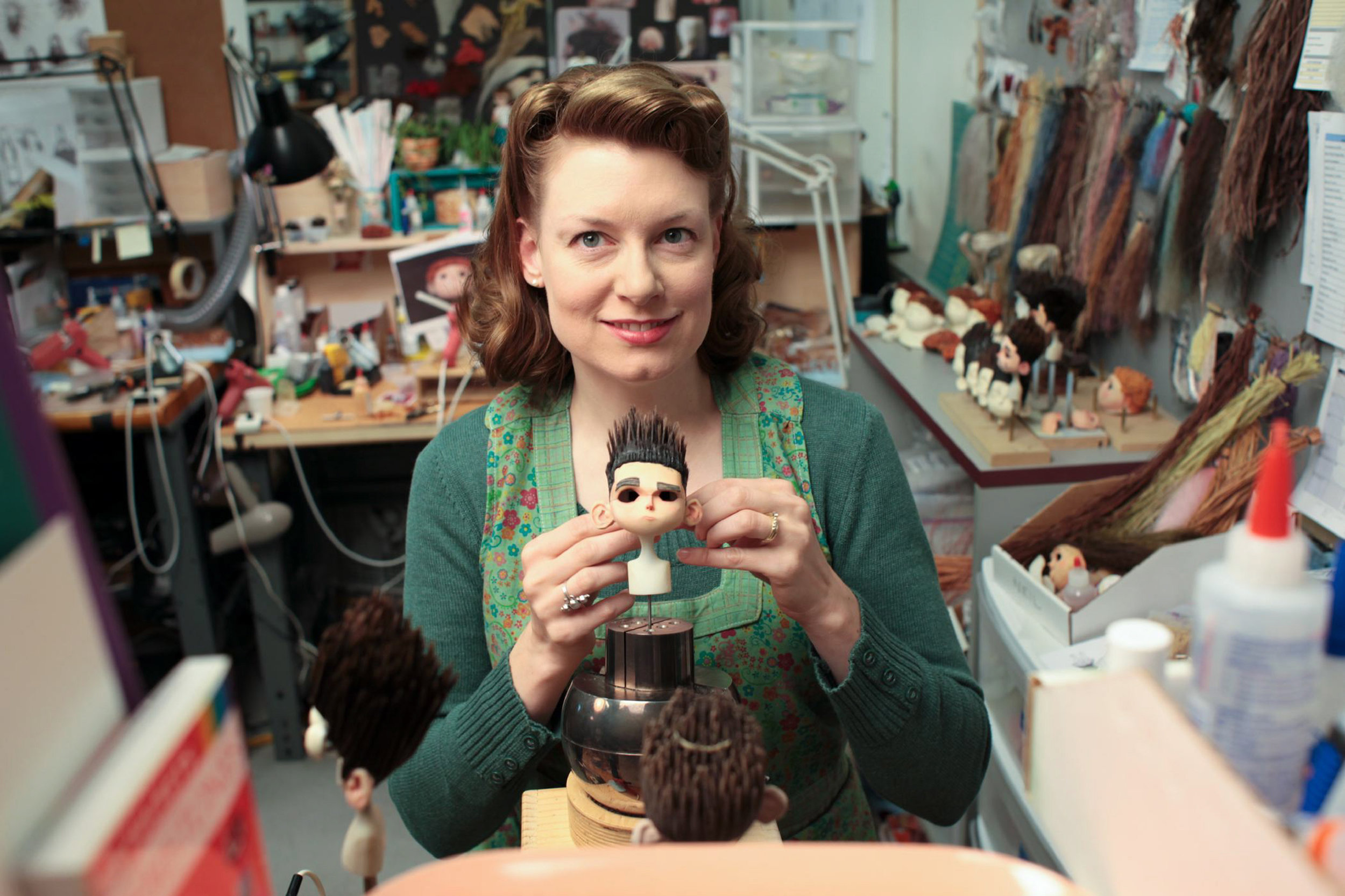 Kristen Riehl holds up Norman-in-progress for ParaNorman, the new 3D stop-motion comedy thriller.  Credit: LAIKA, Inc.