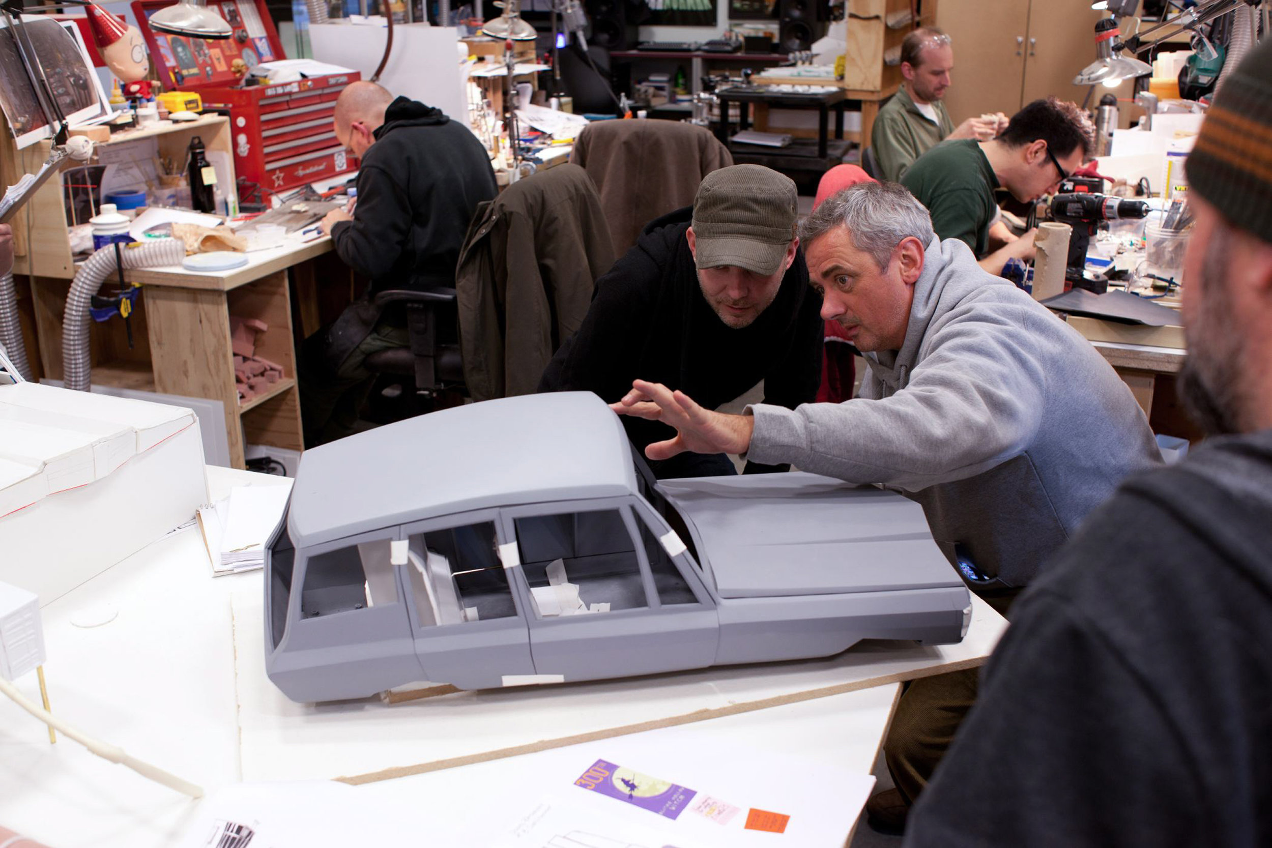 (l to r.) Directors Chris Butler and Sam Fell inspect the family station wagon sculpture for use in ParaNorman, the new 3D stop-motion comedy thriller.  Credit: LAIKA, Inc.