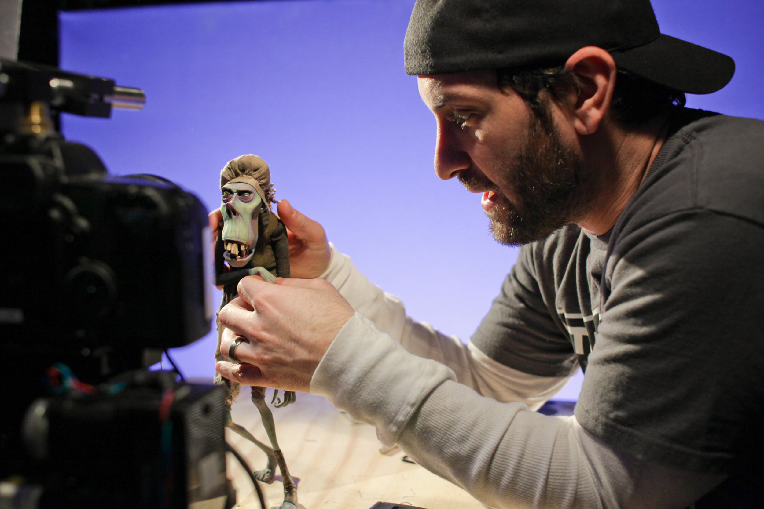 Animation Supervisor Brad Schiff adjusts one of the zombies for his close-up in ParaNorman, the new 3D stop-motion comedy thriller.  Credit: LAIKA, Inc.