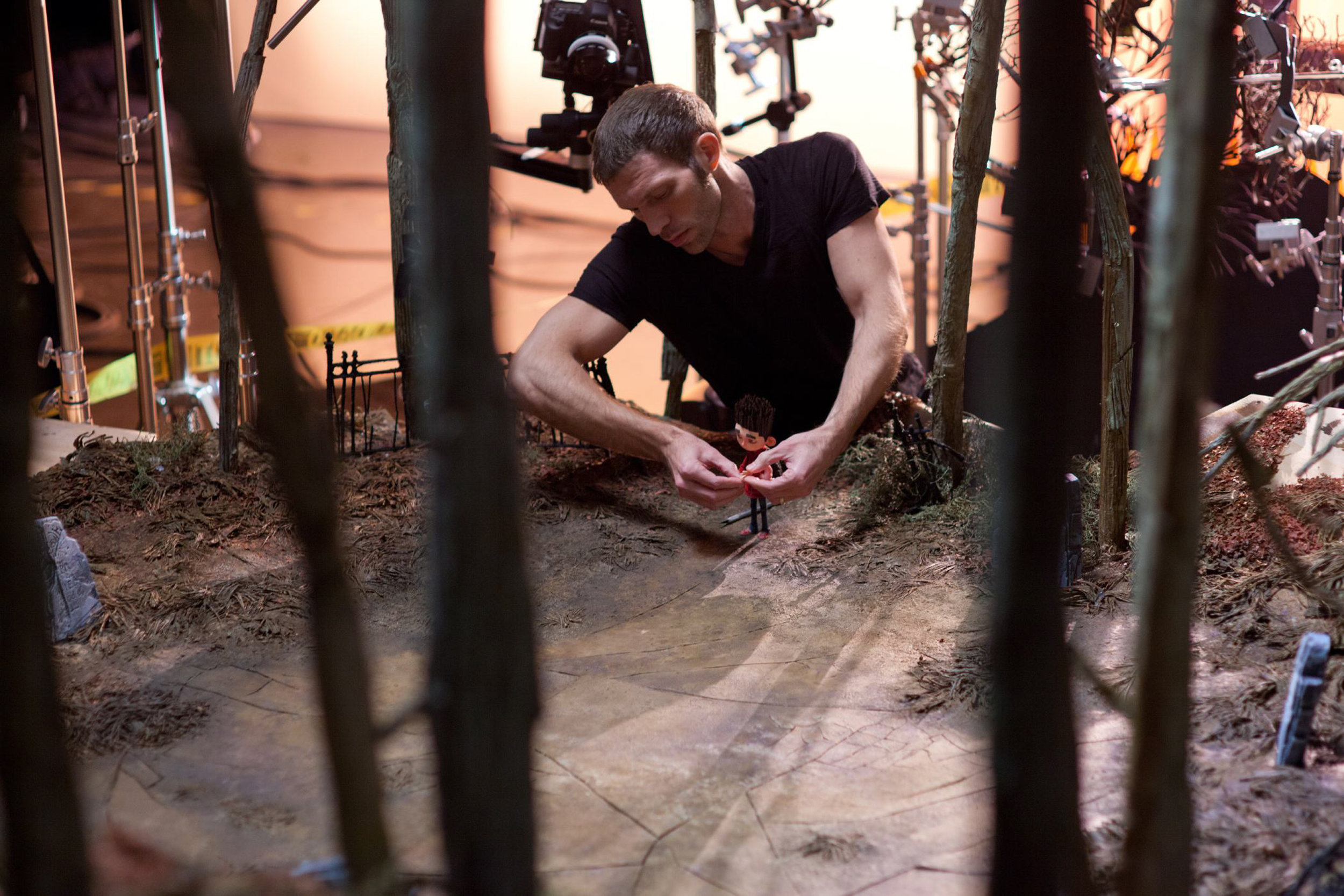 Producer and Head Animator Travis Knight at work with Norman on the graveyard set of ParaNorman, the new 3D stop-motion comedy thriller.  Credit: LAIKA, Inc.