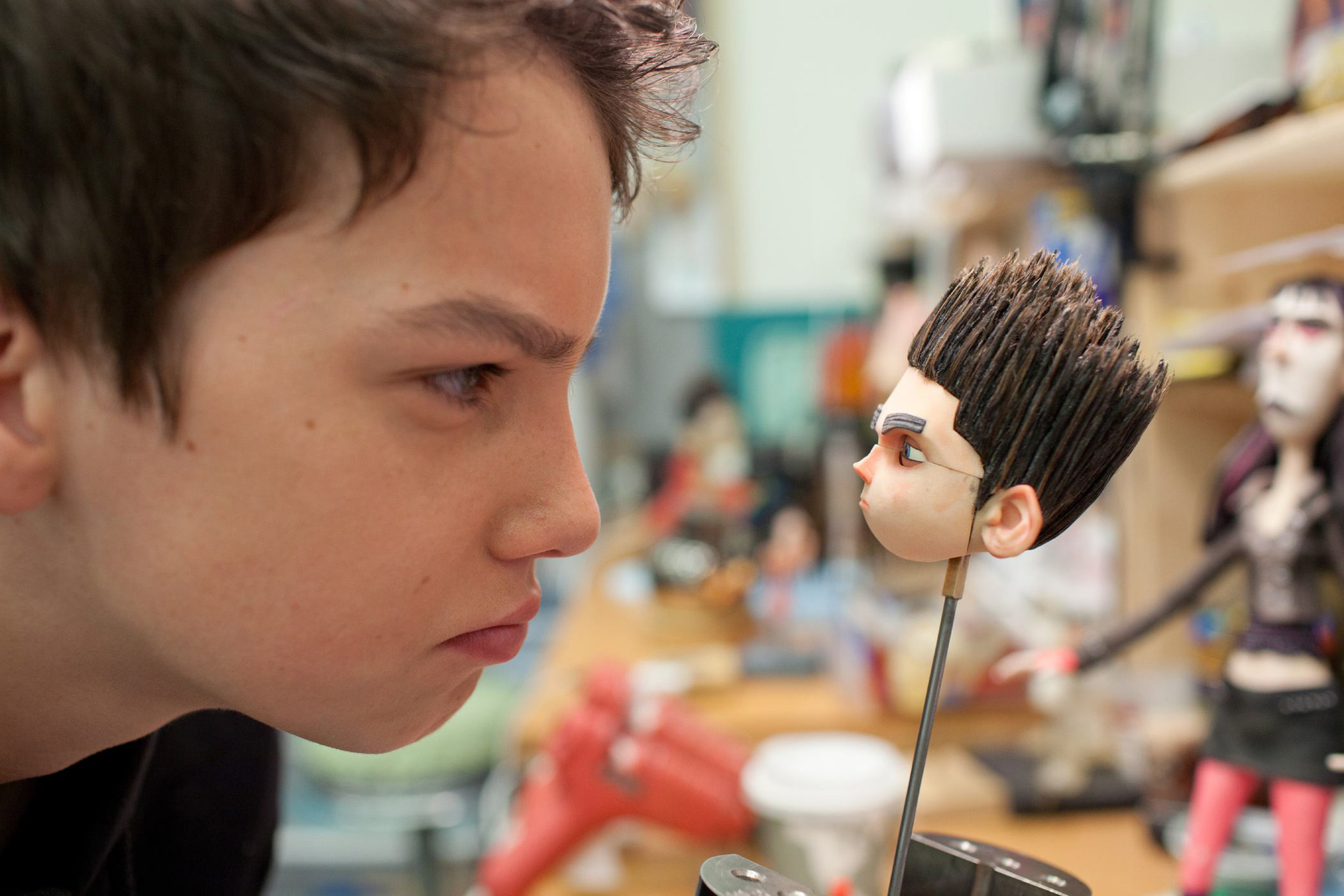 Actor Kodi Smit-McPhee comes face-to-face with an interim face for his character, Norman, ParaNorman is the new 3D stop-motion comedy thriller.  Credit: LAIKA, Inc.