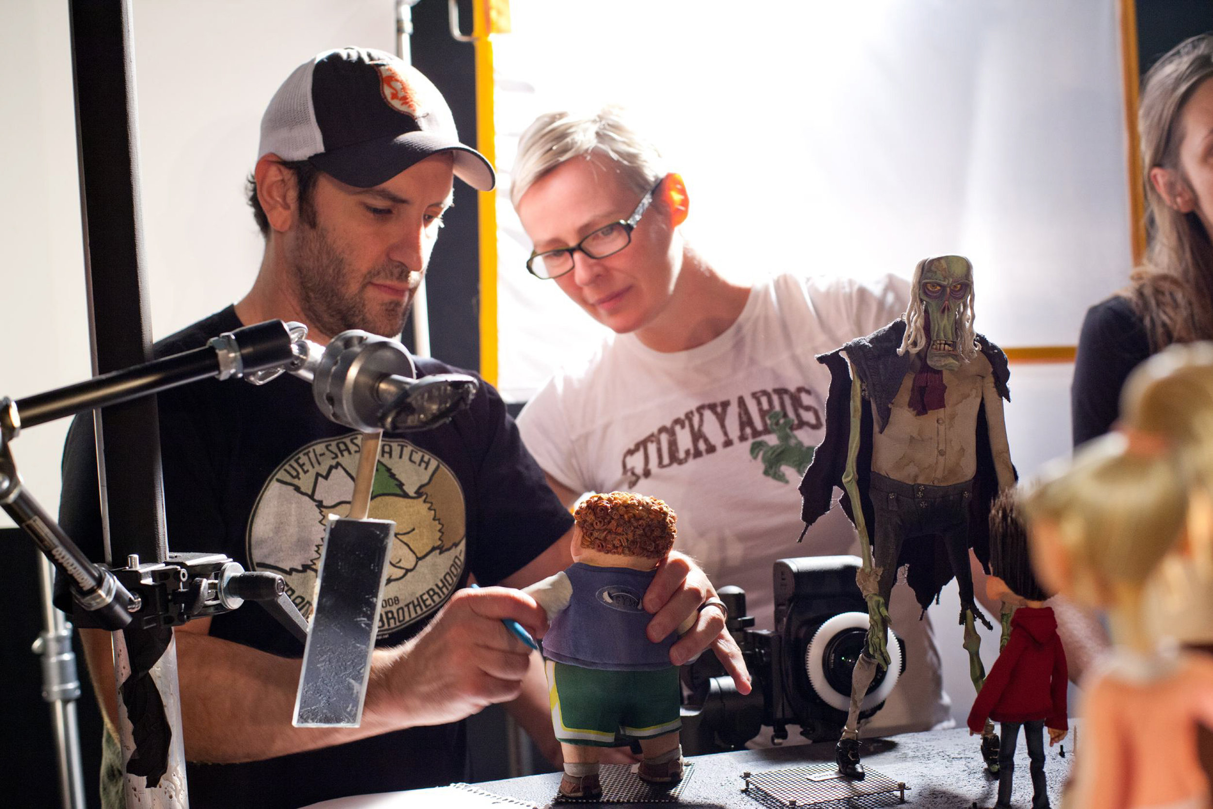 Animation Supervisor Brad Schiff and Creative Supervisor of Puppet Fabrication Georgina Hayns study the Neil puppet for ParaNorman, the new 3D stop-motion comedy thriller.  Credit: LAIKA, Inc.