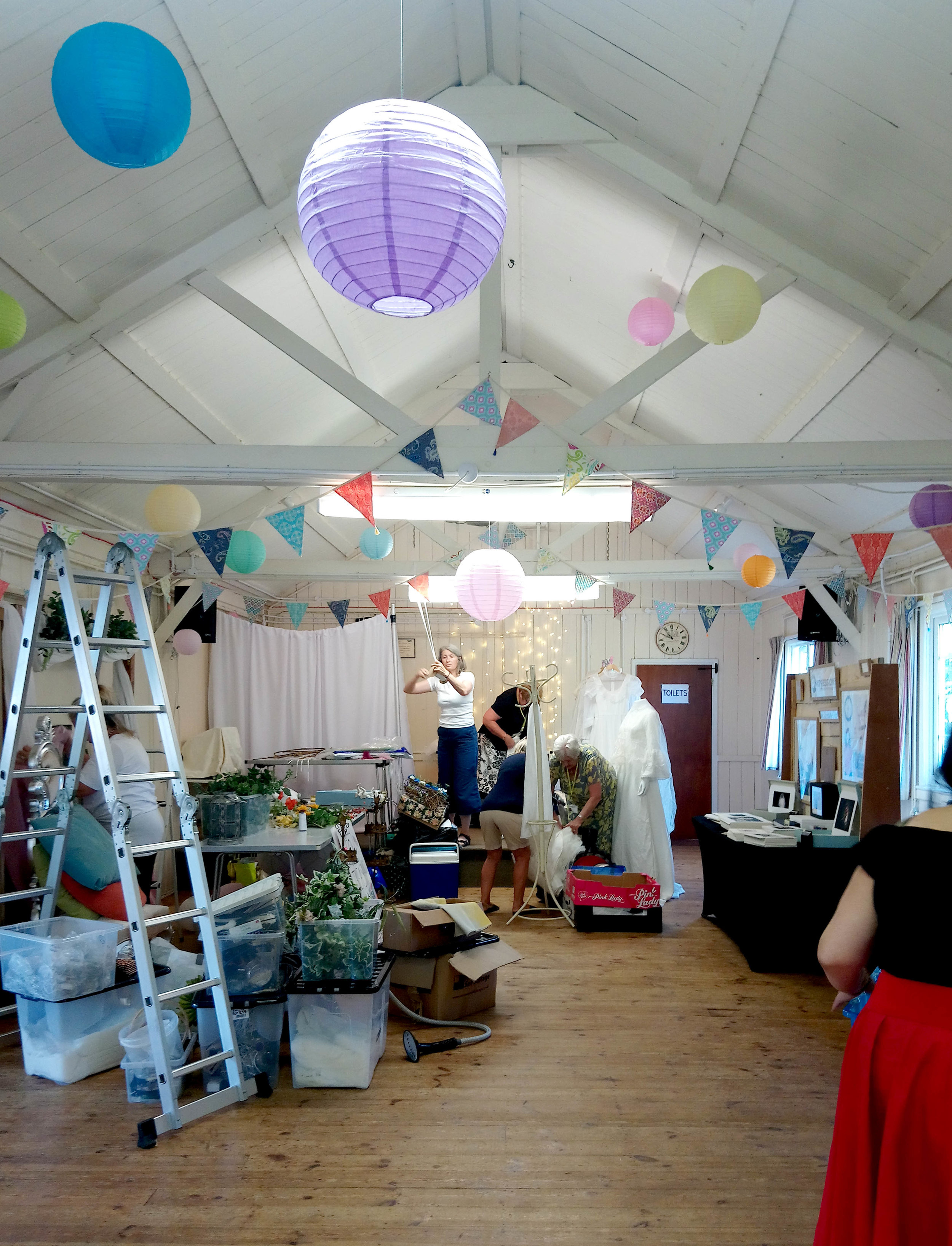 Busy busy, as everyone decorates their stands. I love the quirky post-war feel to this adorable viallge hall – just think of all the prettiness you could hang from the simple, beamed ceiling, to dress theis wedding venue! (All bunting, paper lanterns and venue dressing by  Boomting Bunting ).