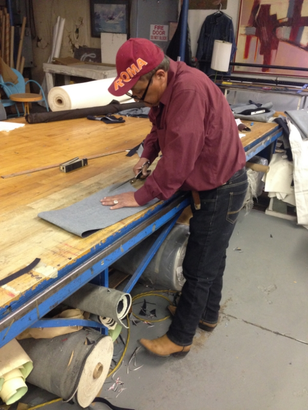 Efrain Garcia working in the jeans he made for himself