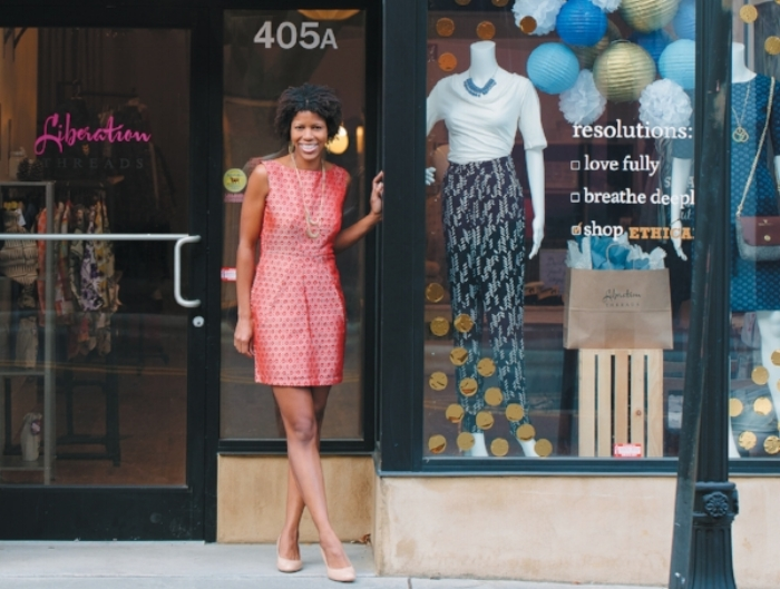 Rebecca Kuhns in front of her boutique: Liberation Threads; photo by Briana Brough