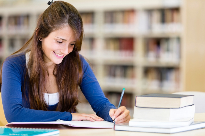 qFemale student studying for sat / act exam