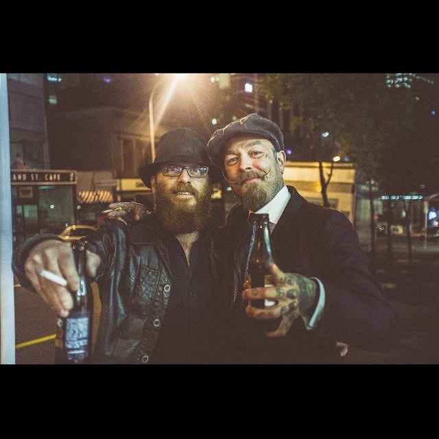 """On the lash with this guy in Auckland NZ!! Humbled to meet and booze with #the_bloody_butcher himself. Crazy how we just released our latest vid inspired by Robs Psycho haircut!! I dunno if Rob remembers much about that night, he did say 'get drunk"""" so we did... man I was hungover the next day! A great night put on by Haircare NZ and The Scumbags!! #schorem #the_bloody_butcher #newcitybarbers #ncb #barber #barberlife #oldskoolbarber #classiccut #menshair #reuzel #reuzelpomade"""