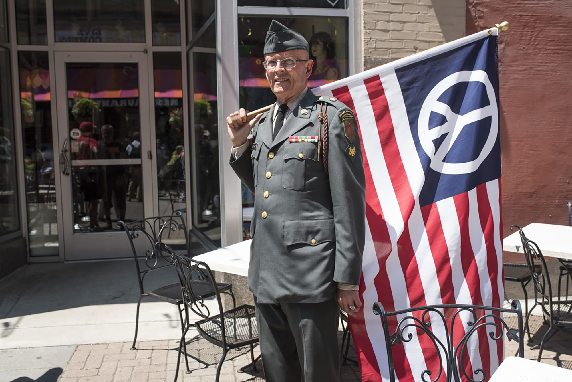 Lou Pumphrey, a Vietnam war veteran who does not support either Presidential Candidates Donald Trump or Hillary Clinton, participates in protests during day two of the Republican National Convention in downtown Cleveland, Tuesday, July 19th, 2016.