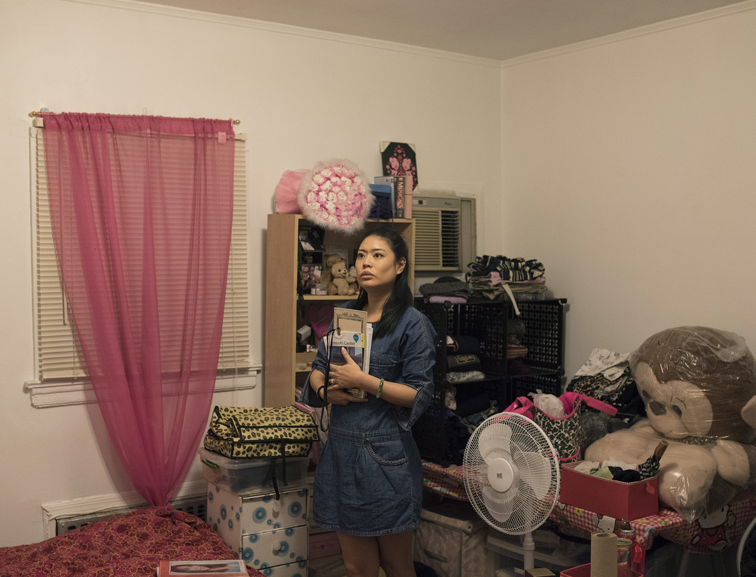 Ya Han Chang reflecting on her day at her home in Rego Park, Queens. NY, on Friday, May 27th 2016. ( G-Jun Yam /NYT Institute)