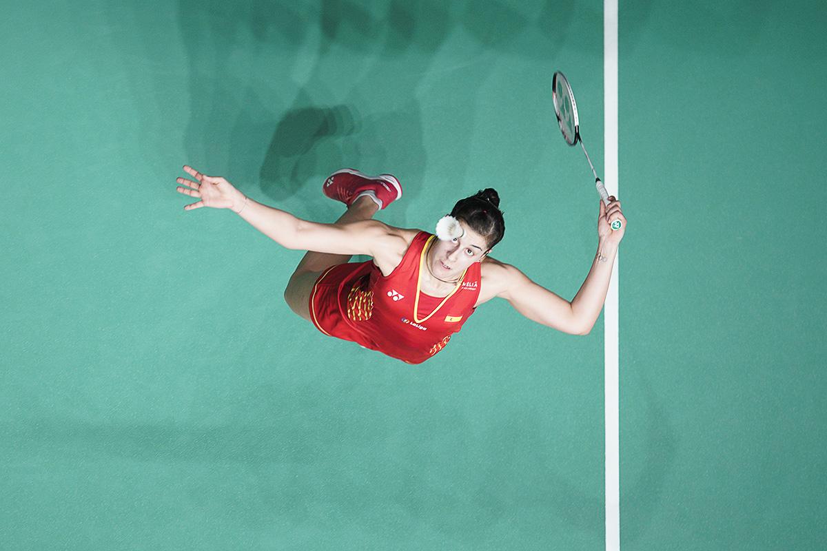 Carolina Marin of Spain returns a shot to Sung Ji Hyun of South Korea during the women's singles quarterfinals of the Malaysia Masters badminton tournament in Kuala Lumpur, Malaysia, Friday, Jan. 18, 2019. (AP Photo/Yam G-Jun)