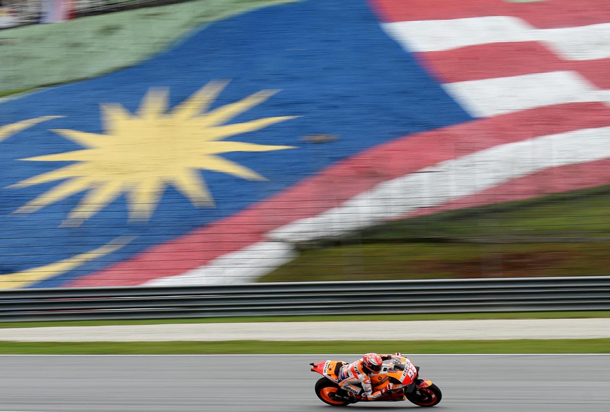 Honda rider Marc Marquez of Spain rides his bike during qualifying at the Sepang International Circuit in Sepang, Malaysia, Saturday, Nov. 3, 2018. (AP Photo/Yam G-Jun)