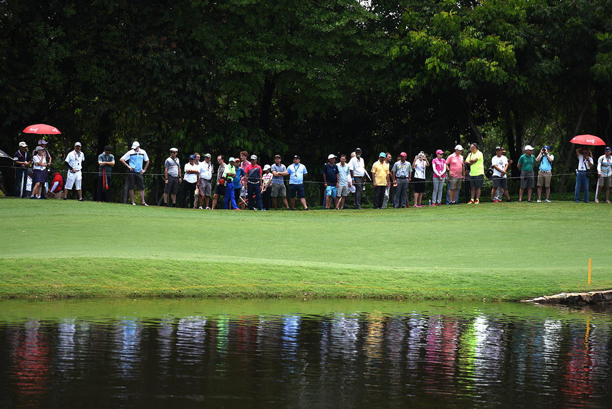 Spectators watch the final round of the CIMB Classic golf tournament at Tournament Players Club (TPC) in Kuala Lumpur, Malaysia, Sunday, Oct. 14, 2018. (AP Photo/Yam G-Jun)