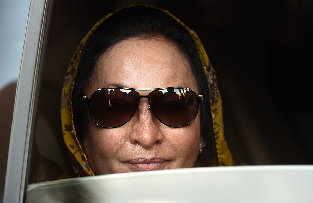 Former Malaysian Prime Minister wife Rosmah Mansor leaves Kuala Lumpur High Court after a court hearing in Kuala Lumpur, Malaysia, Thursday, Nov. 15, 2018