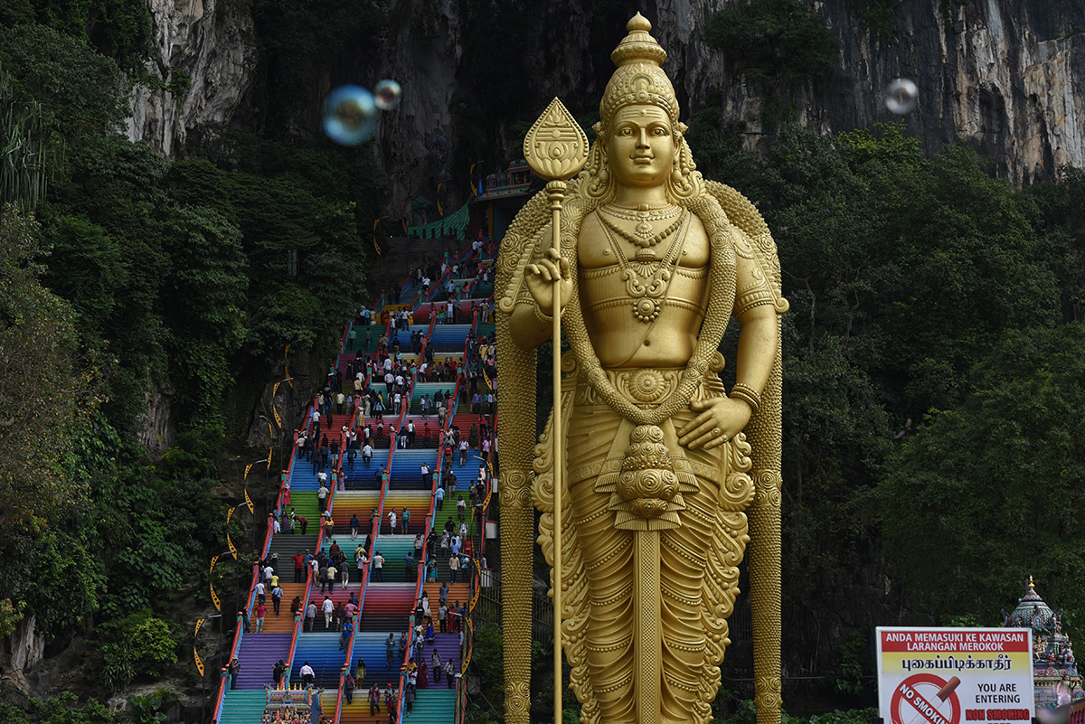 Hindu devotees climb the colored stairs to pray at the Batu Caves Temple during the Deepavali celebration in Selangor, Malaysia, Tuesday, Nov. 6, 2018. (AP Photo/Yam G-Jun)