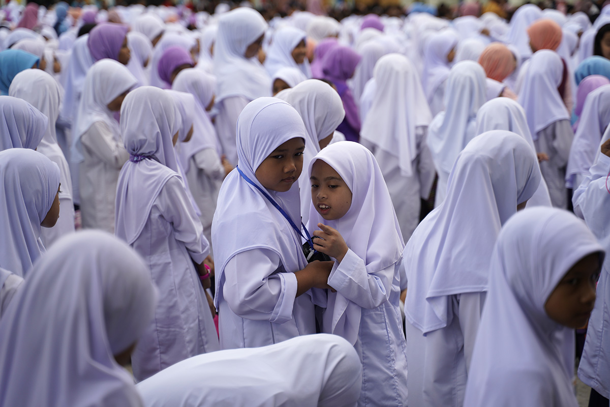 Primary school students talk during the first day of the new school session in Putrajaya, Malaysia, Wednesday, Jan. 2, 2019. Malaysia began the first day of new school session on Jan. 2. (AP Photo/Yam G-Jun)