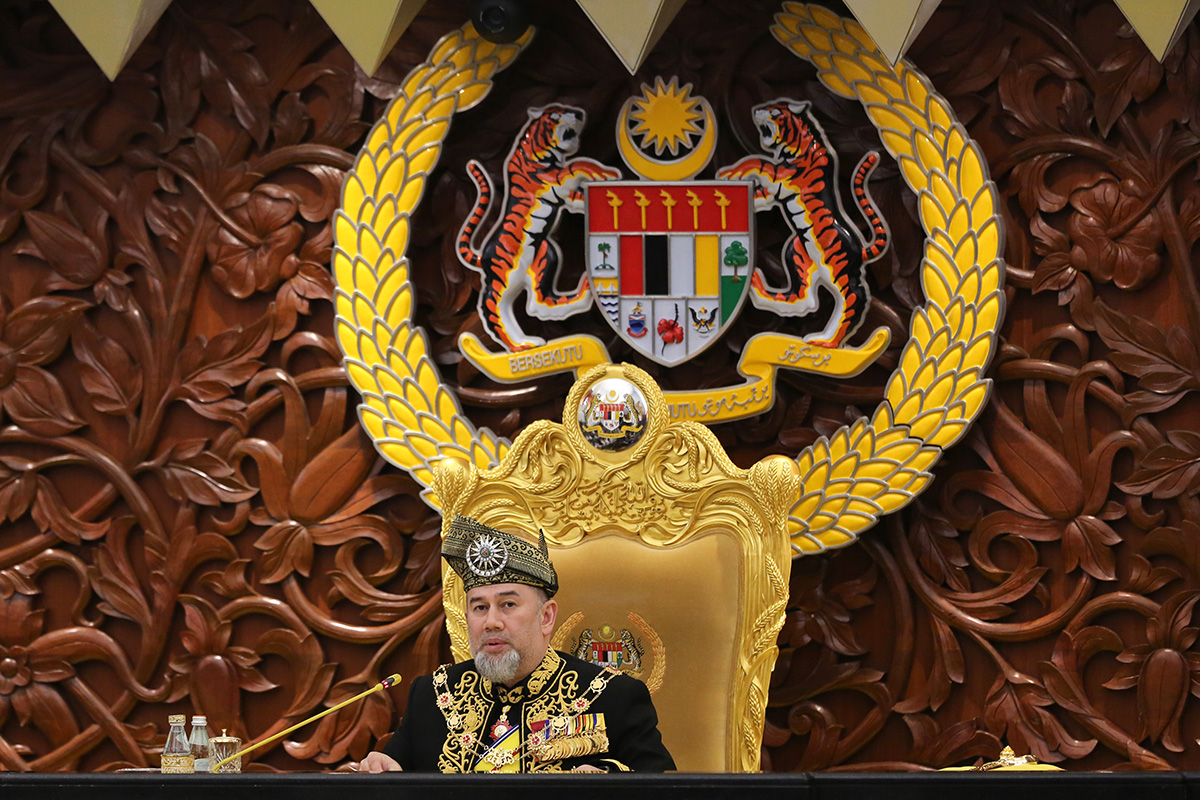 Malaysia King Sultan Muhammad V delivers the opening speech during the opening of the 14th parliament session at the Parliament house in Kuala Lumpur, Malaysia, Tuesday, July 17, 2018. (AP Photo/Yam G-Jun)