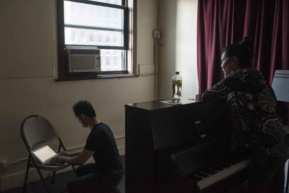 A student records Ms. Chang's feedback during a private singing lesson. G-Jun Yam / NYT Institute
