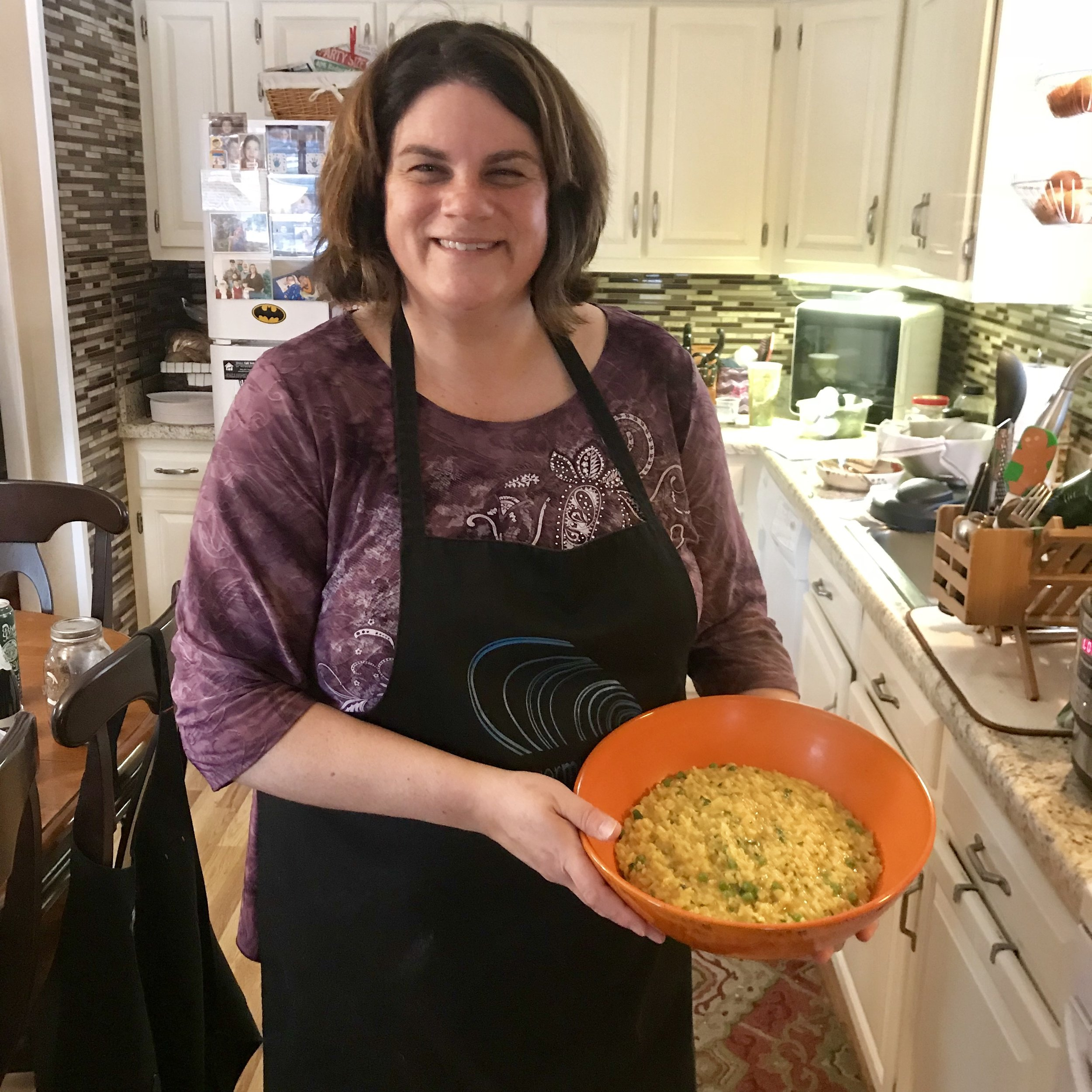 Private cooking student Molly, and a pot of her fresh cooked risotto.