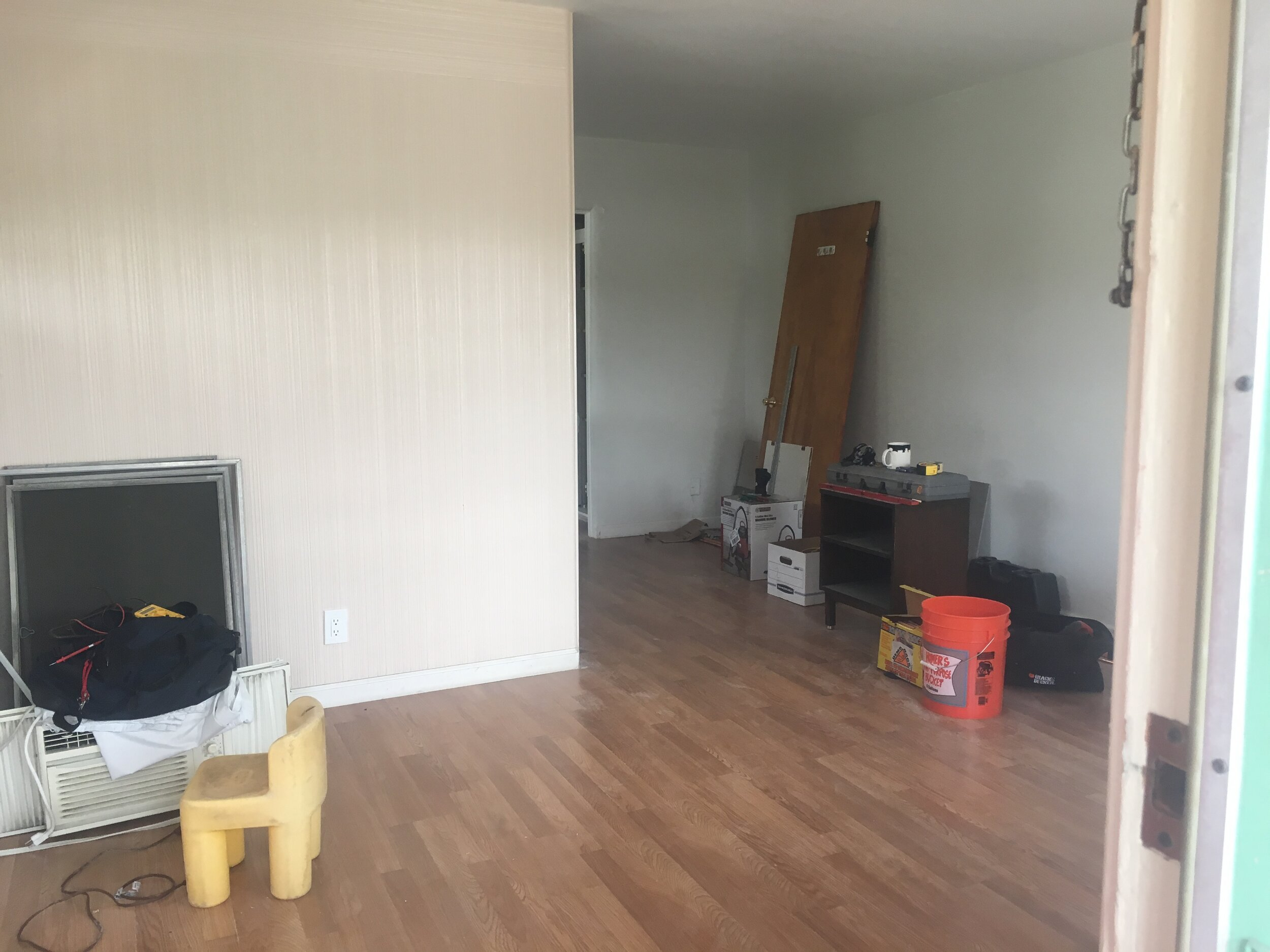 Before: A wall separated the living room and the kitchen