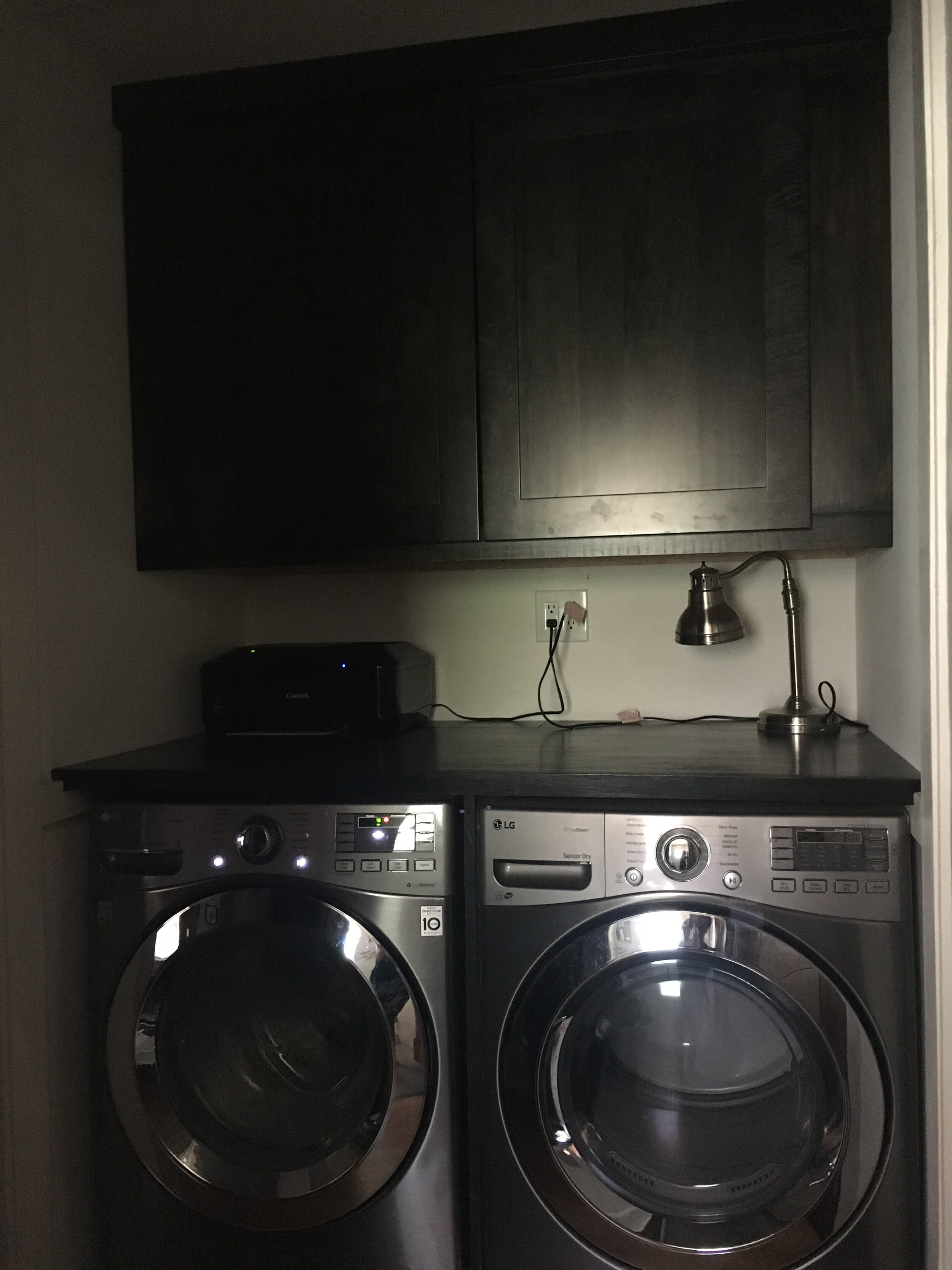 Across the bathroom, another dead space paved way for a washer/dryer and more cabinet space!