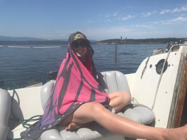 Monica relaxing on the boat in a butterfly costume