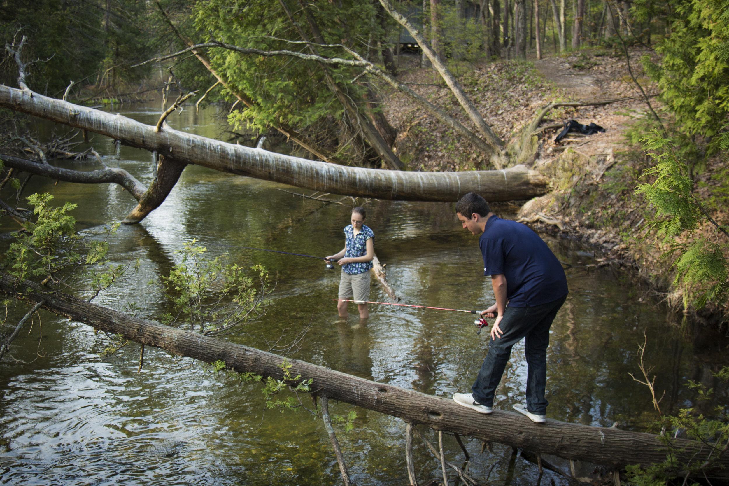 students_fishing_river.jpg