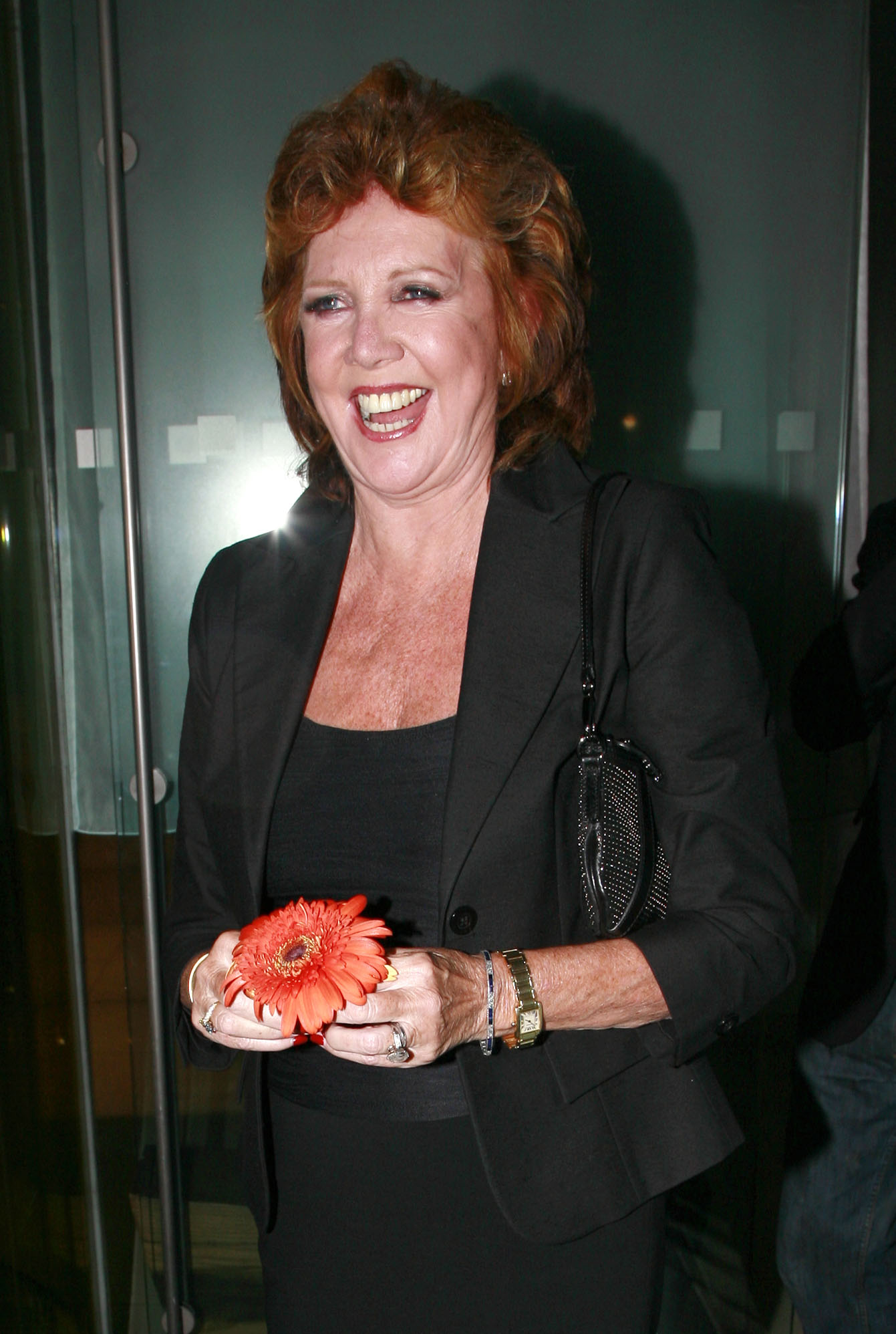 Cilla has a chuckle as all the photographers sing the Blind Date theme tune to her leaving Bungalow 8