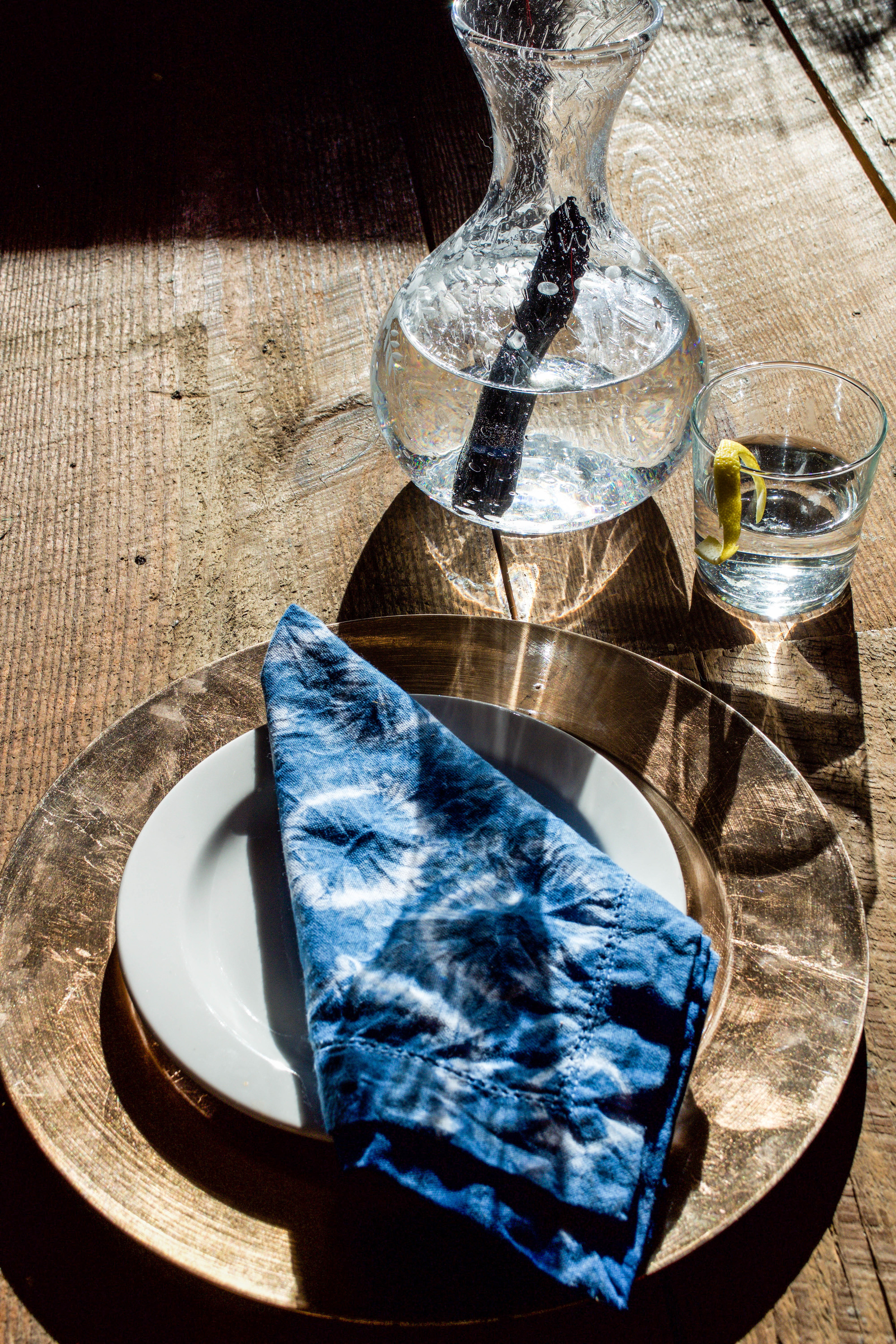 Hand dyed napkins with  Apprvl Dye Kit . Pitcher of purified water with Kishu Binchotan Charcoal.