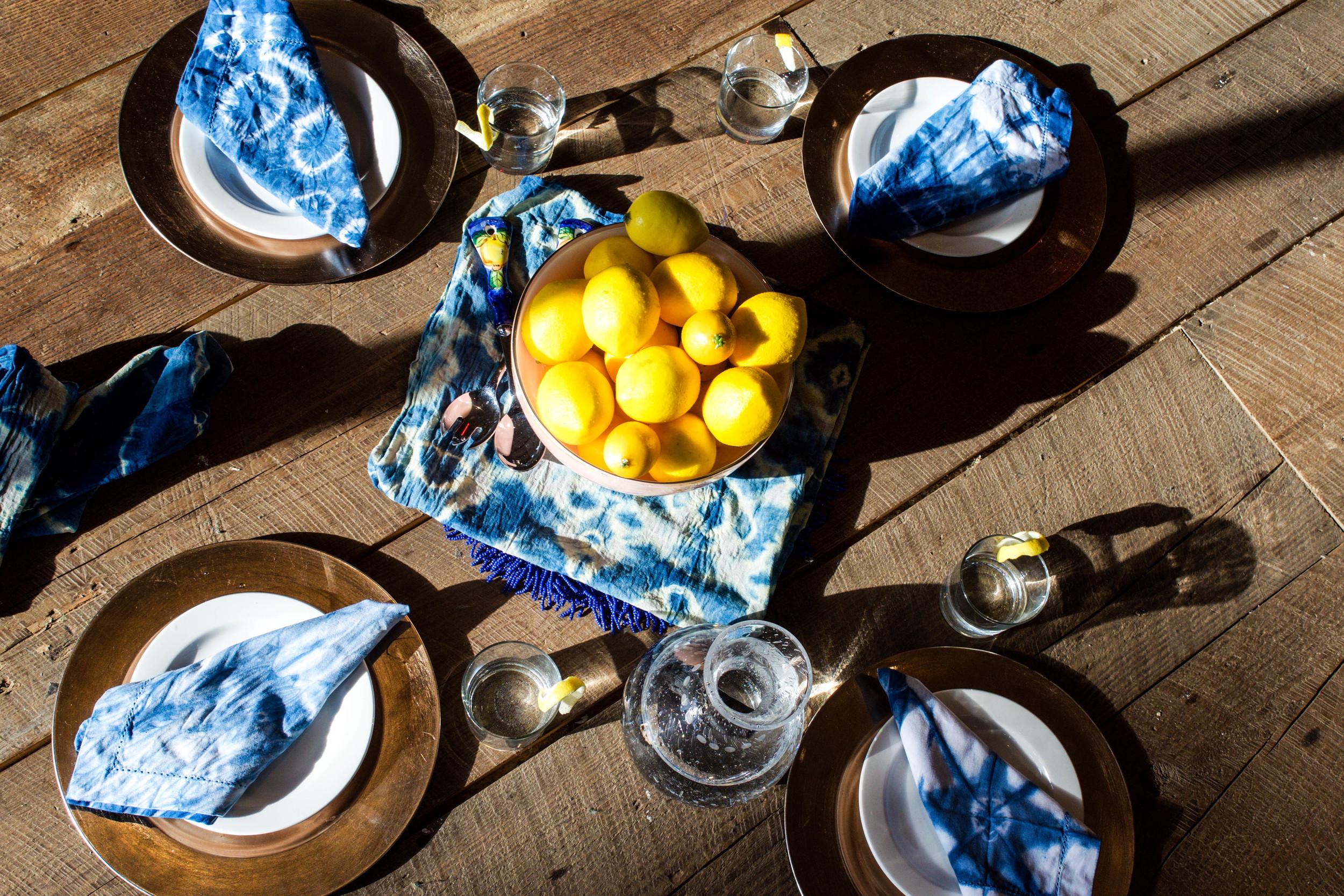 Summer table setting lemons and indigo tie dye napkins