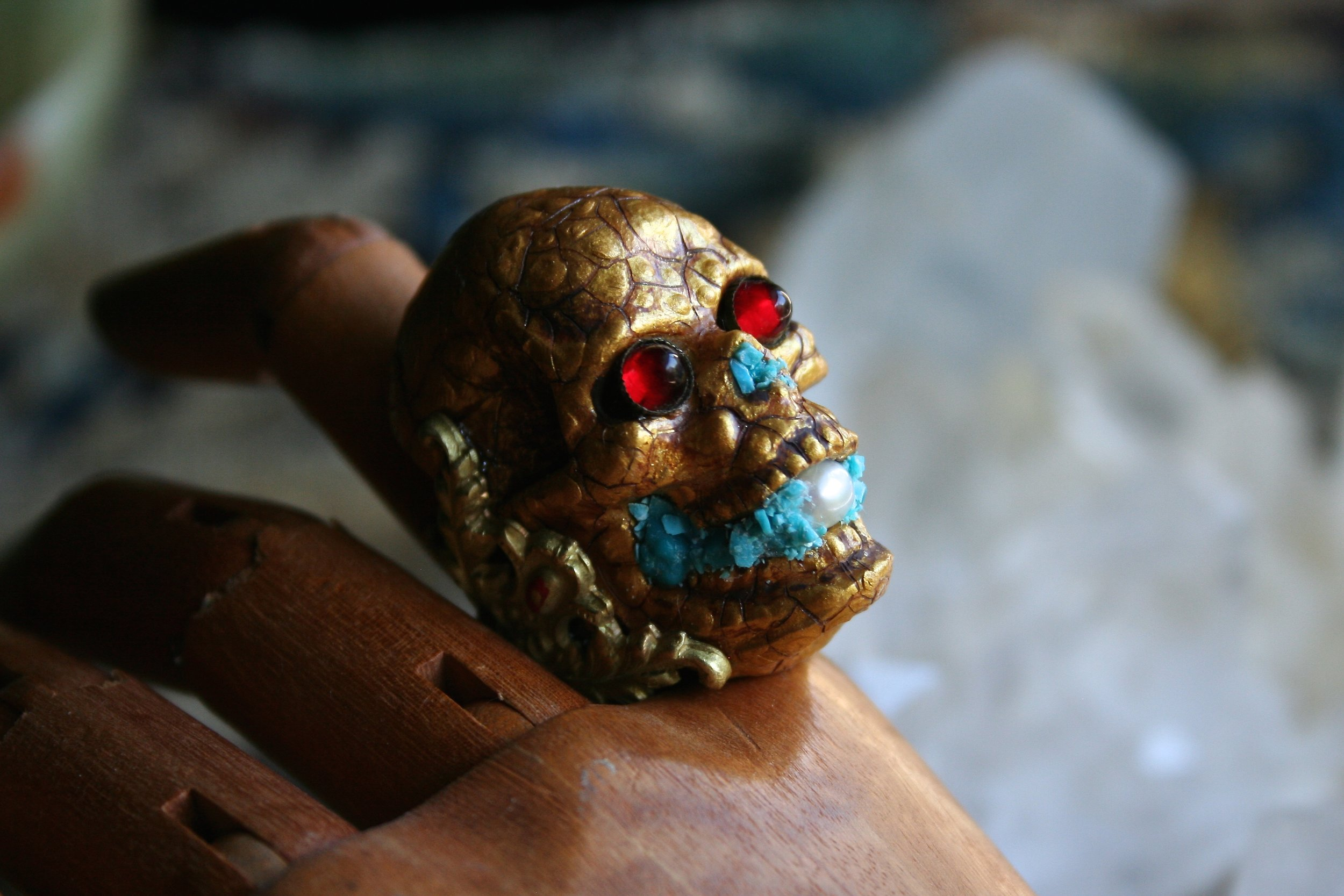 The inspiration for this piece came from divine a Renaissance period skull ring I once saw in a museum in London. My rendition is adhered to a ring blank, dressed in gold paint, crackle medium, antique ruby red glass cabochons, crushed turquoise and one saltwater baroque vintage pearl. I'm planning on wearing him while giving out Halloween candy to our neighbor kids!   Click  Here  to purchase.